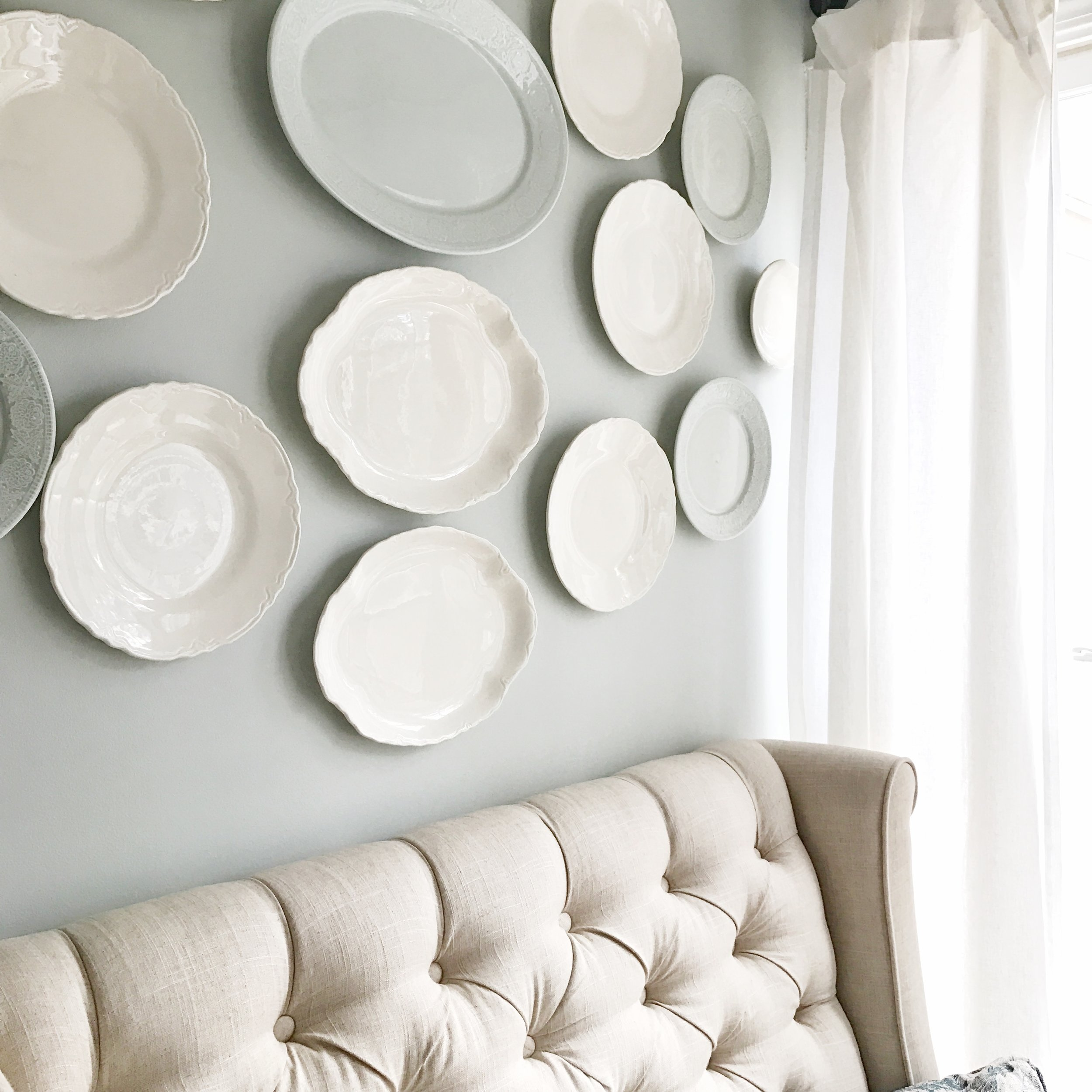 Home Tour- Farmhouse Style Breakfast Nook with a White DIY Plate Wall by Plum Pretty Decor and Design