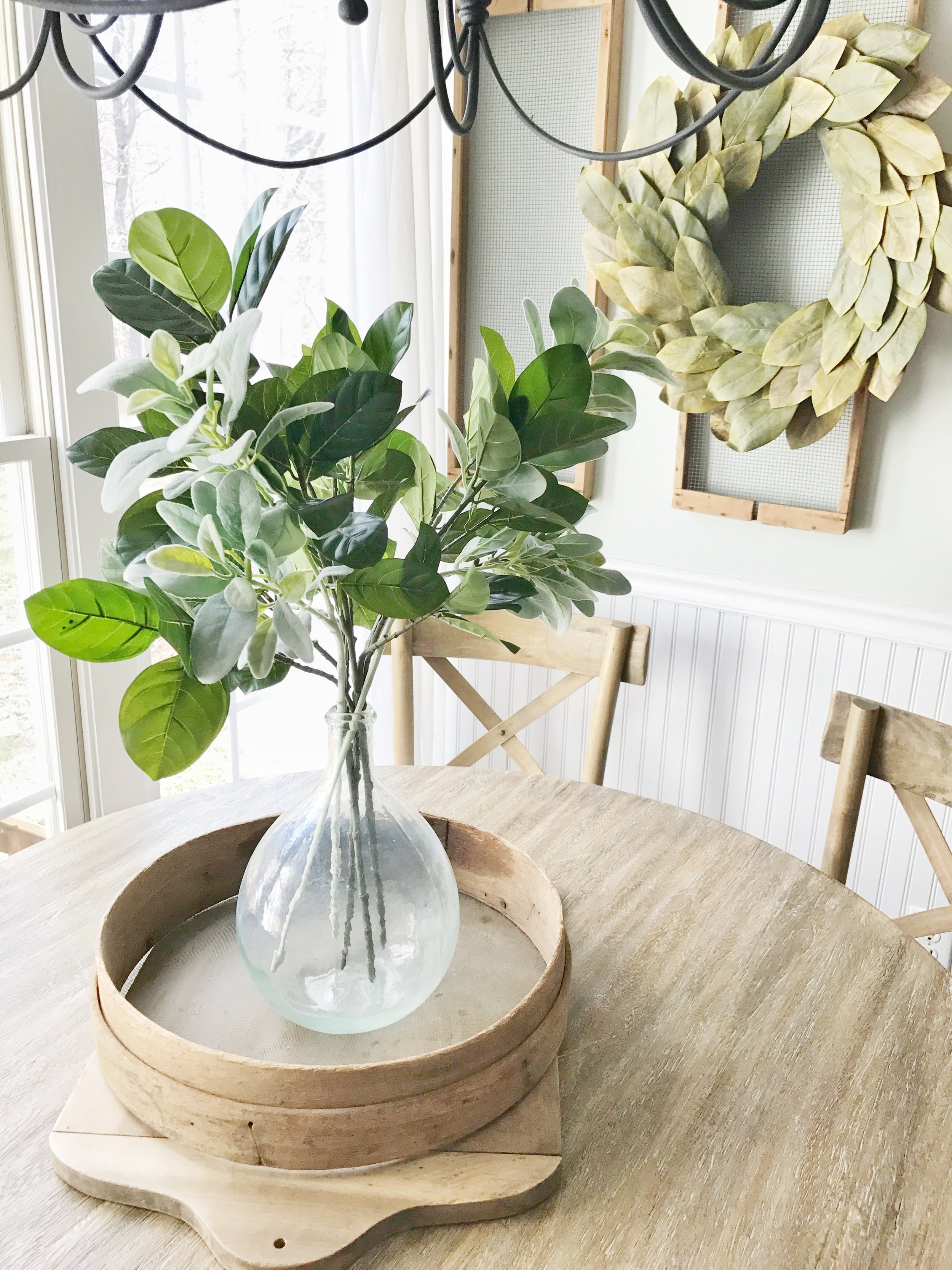 Home Tour- Farmhouse Style Breakfast Nook with a Layered Centerpiece with Antique Cutting Board, Sifter, and European Demijohn by Plum Pretty Decor and Design