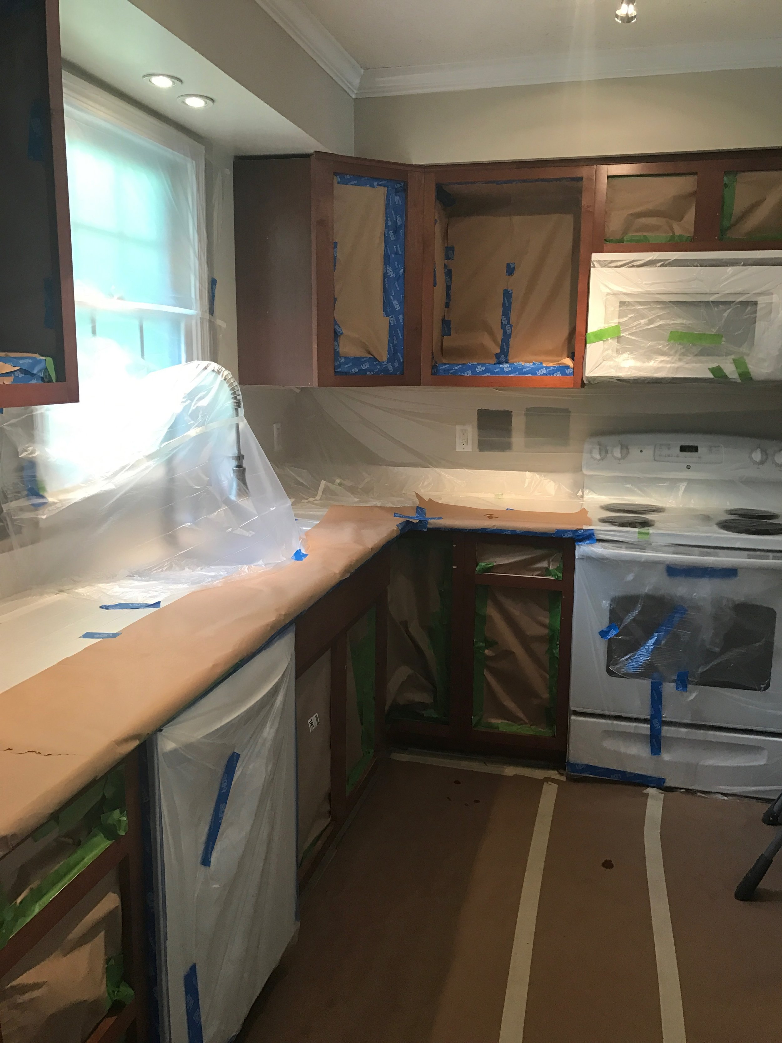 Painted_Kitchen_Cabinets_Prep_Taping_Off_To_Paint.JPG