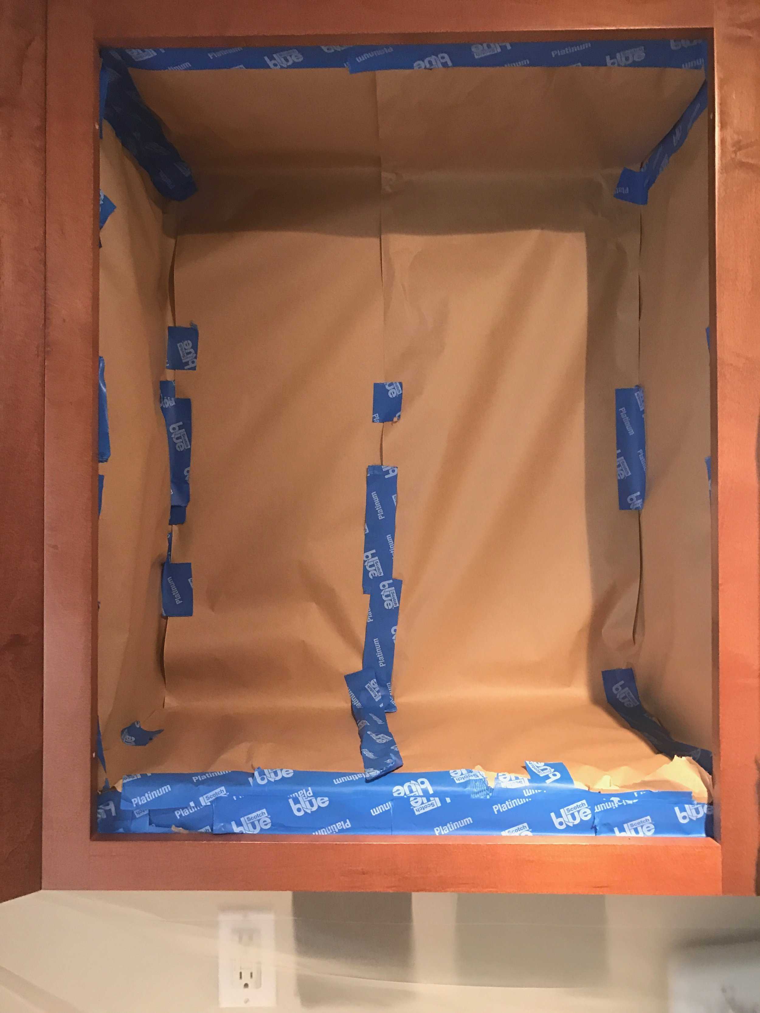Painted_Kitchen_Cabinets_Taping_Inside_Of_Cabinets_Off.JPG