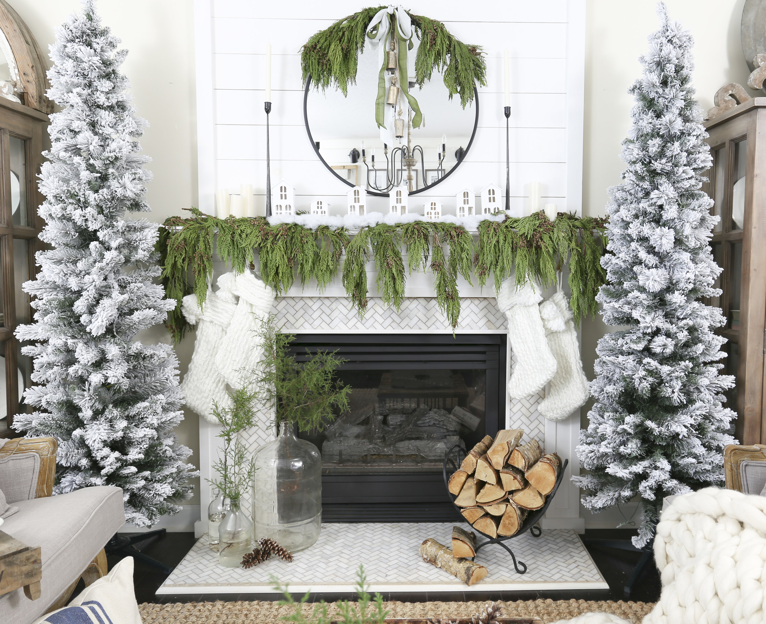 Christmas 2017 Home Tour: Deck The Blogs- Living Room Fireplace Mantel Decor with Flocked Trees and White House Village- Plum Pretty Decor & Design's Christmas Home Tour