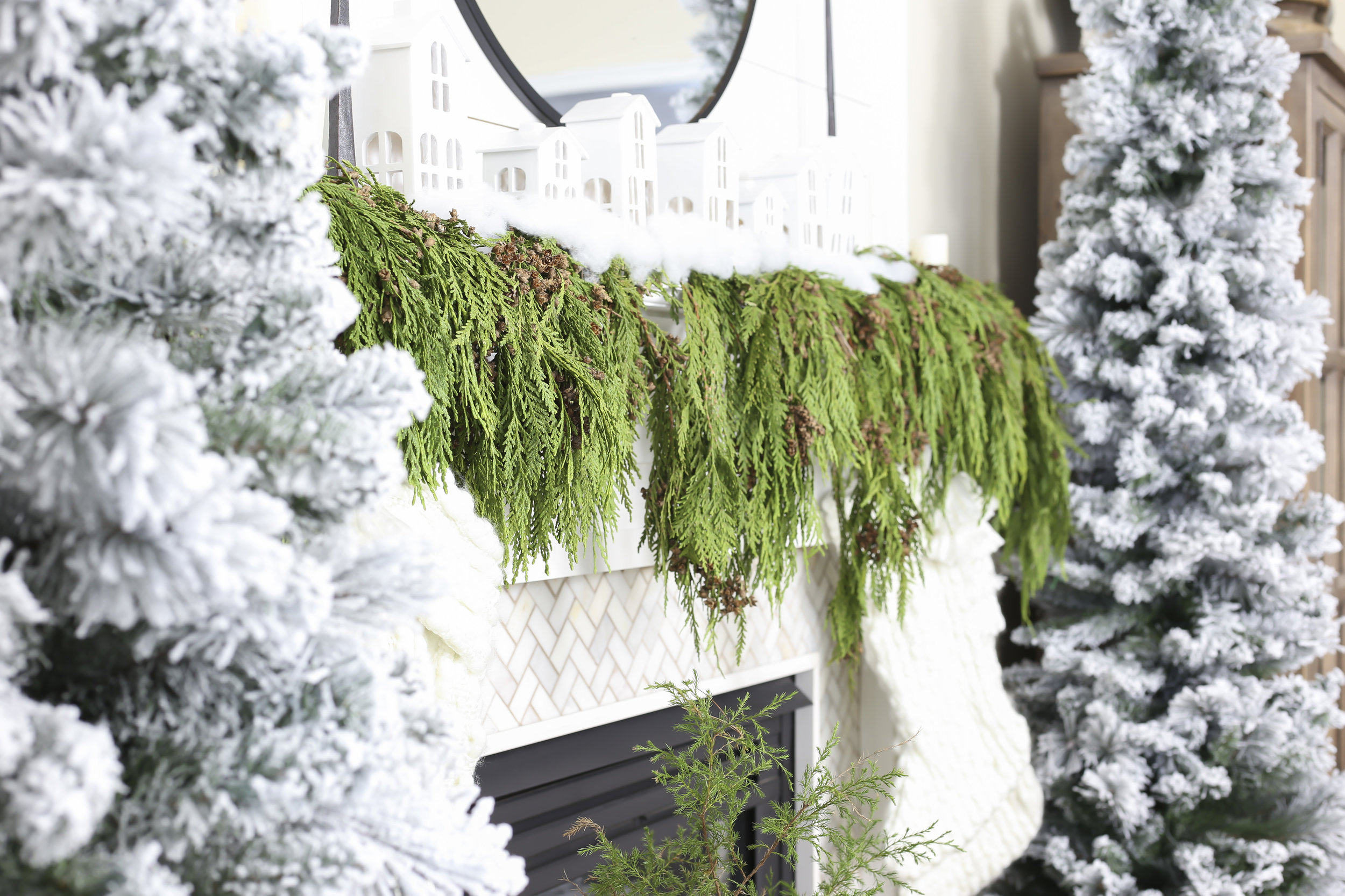 Christmas 2017 Home Tour: Deck The Blogs- Live Garland Mantel Decor with Stockings and Village Scene- Plum Pretty Decor & Design's Christmas Home Tour
