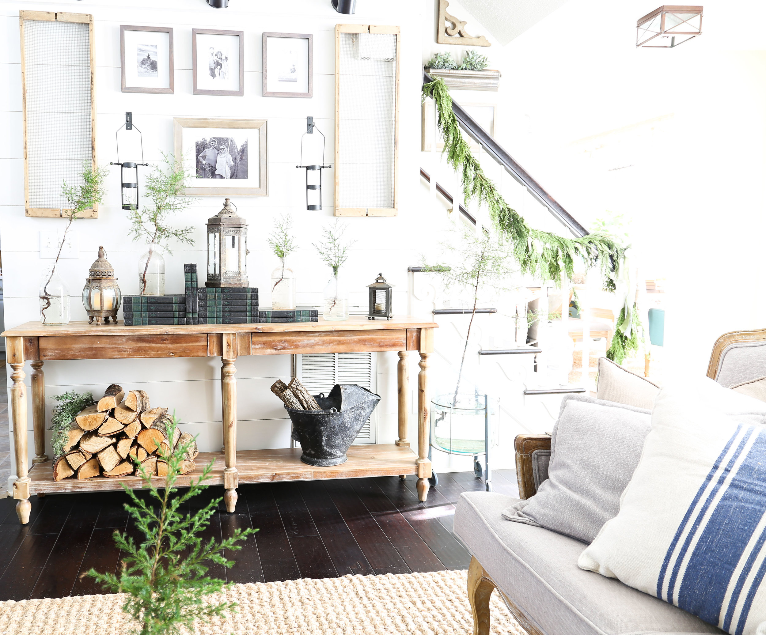 Christmas 2017 Home Tour: Deck The Blogs- Styled Everett Console Table Books and Wood- Plum Pretty Decor & Design's Christmas Home Tour