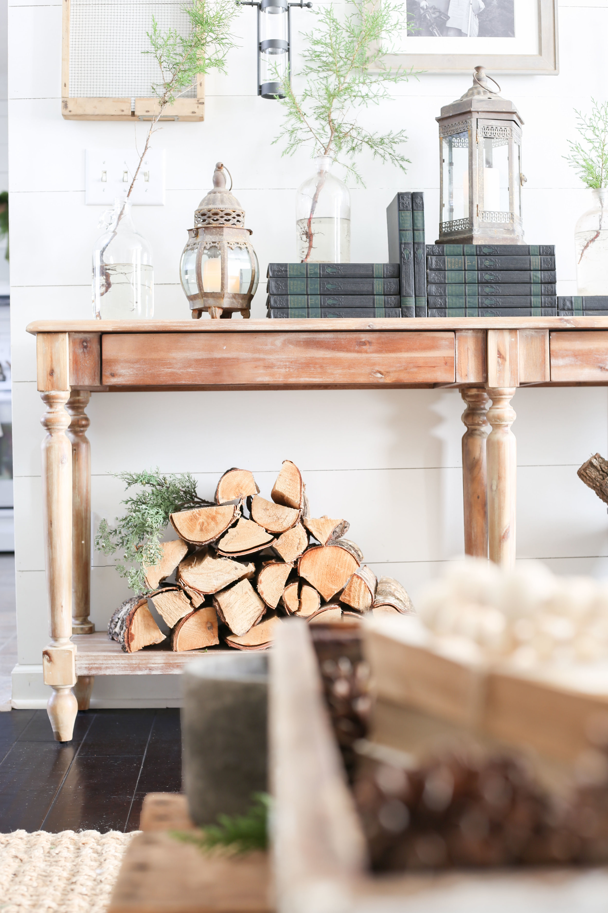 Christmas 2017 Home Tour: Deck The Blogs- Christmas Styled Console Table with Wood Logs- Plum Pretty Decor & Design's Christmas Home Tour