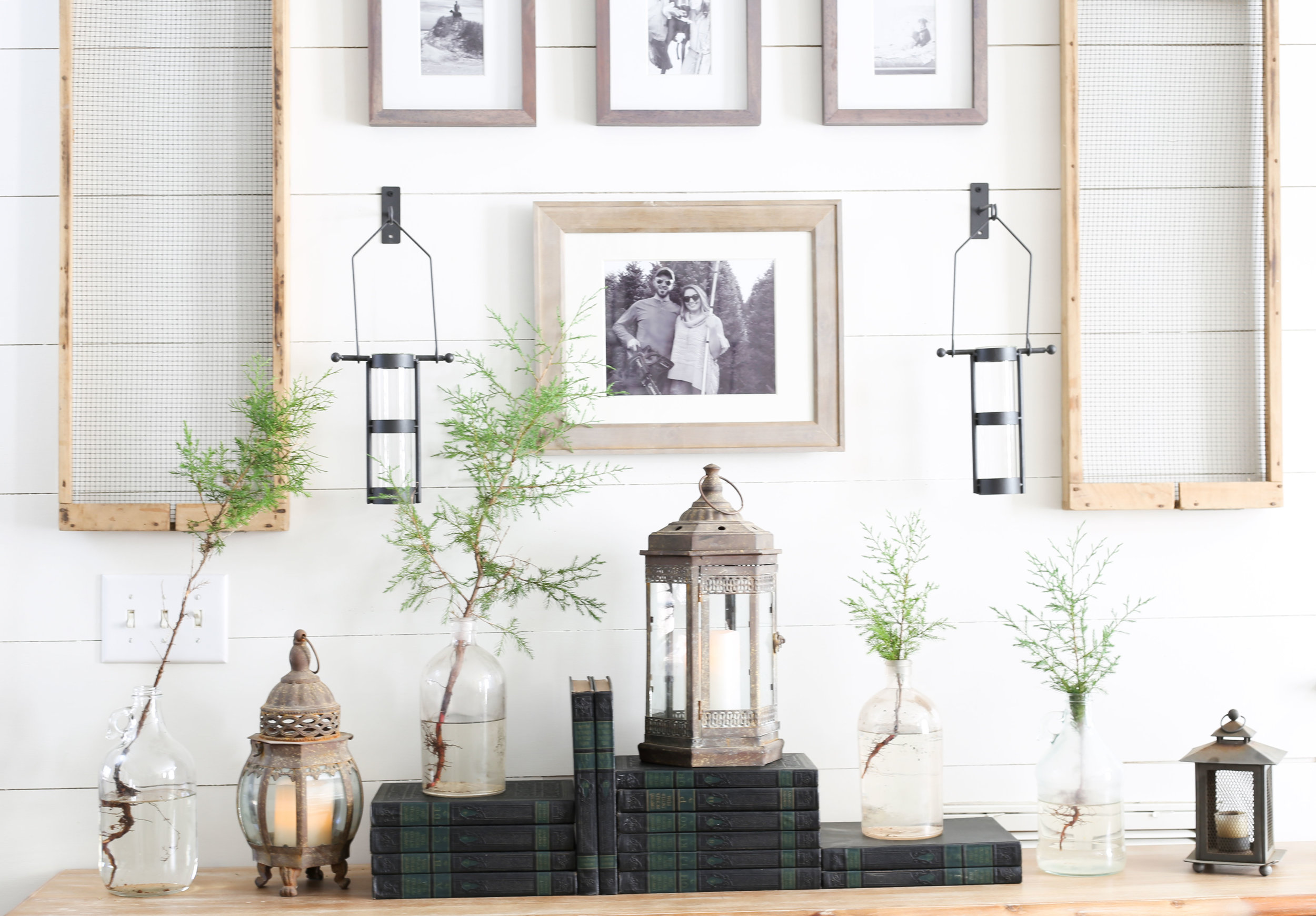 Christmas 2017 Home Tour: Deck The Blogs- Christmas Table with old books and pine trees in bottles- Plum Pretty Decor & Design's Christmas Home Tour