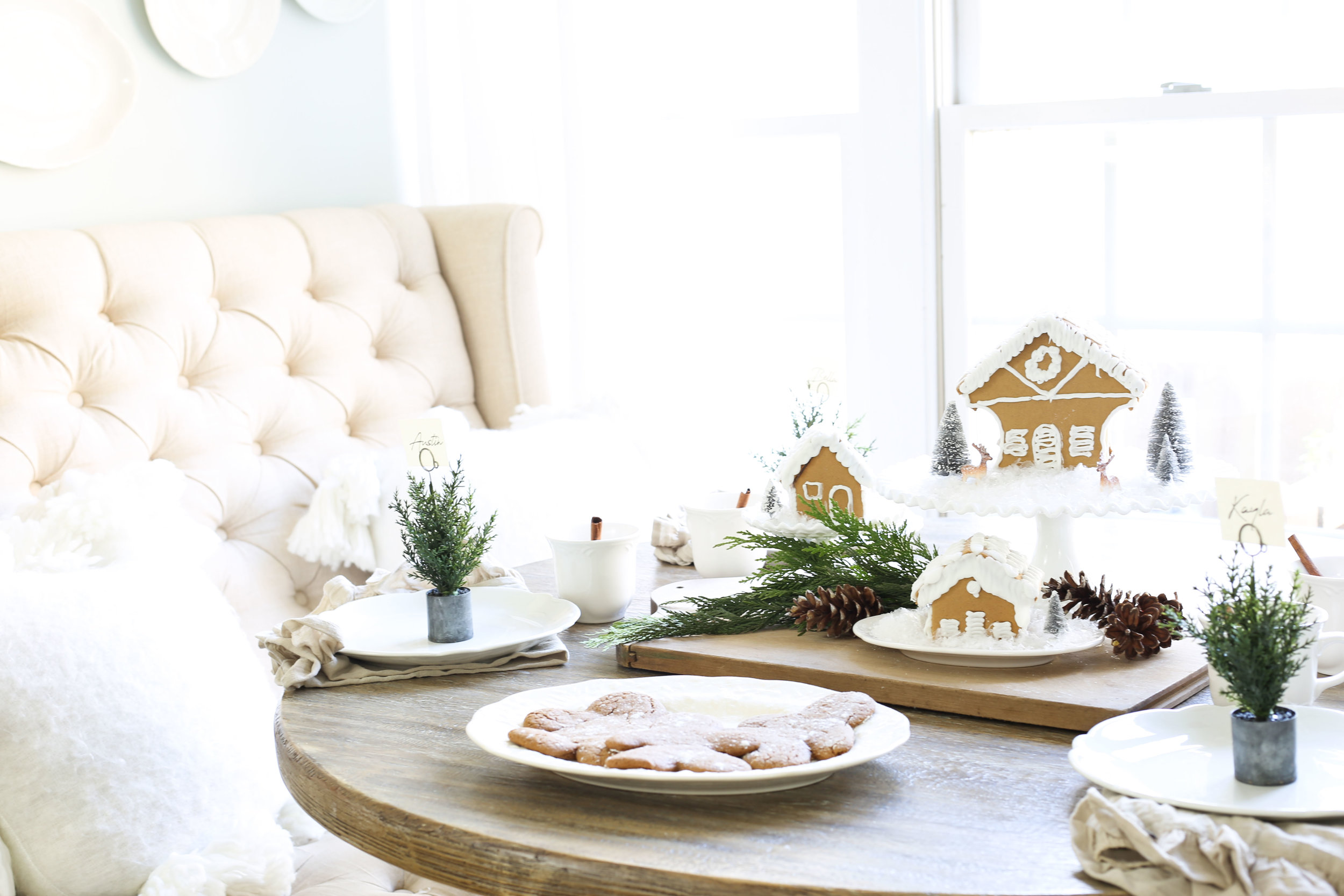 Christmas 2017 Home Tour: Deck The Blogs- Breakfast Nook Table Setting with Gingerbread House Centerpiece- Plum Pretty Decor & Design's Christmas Home Tour