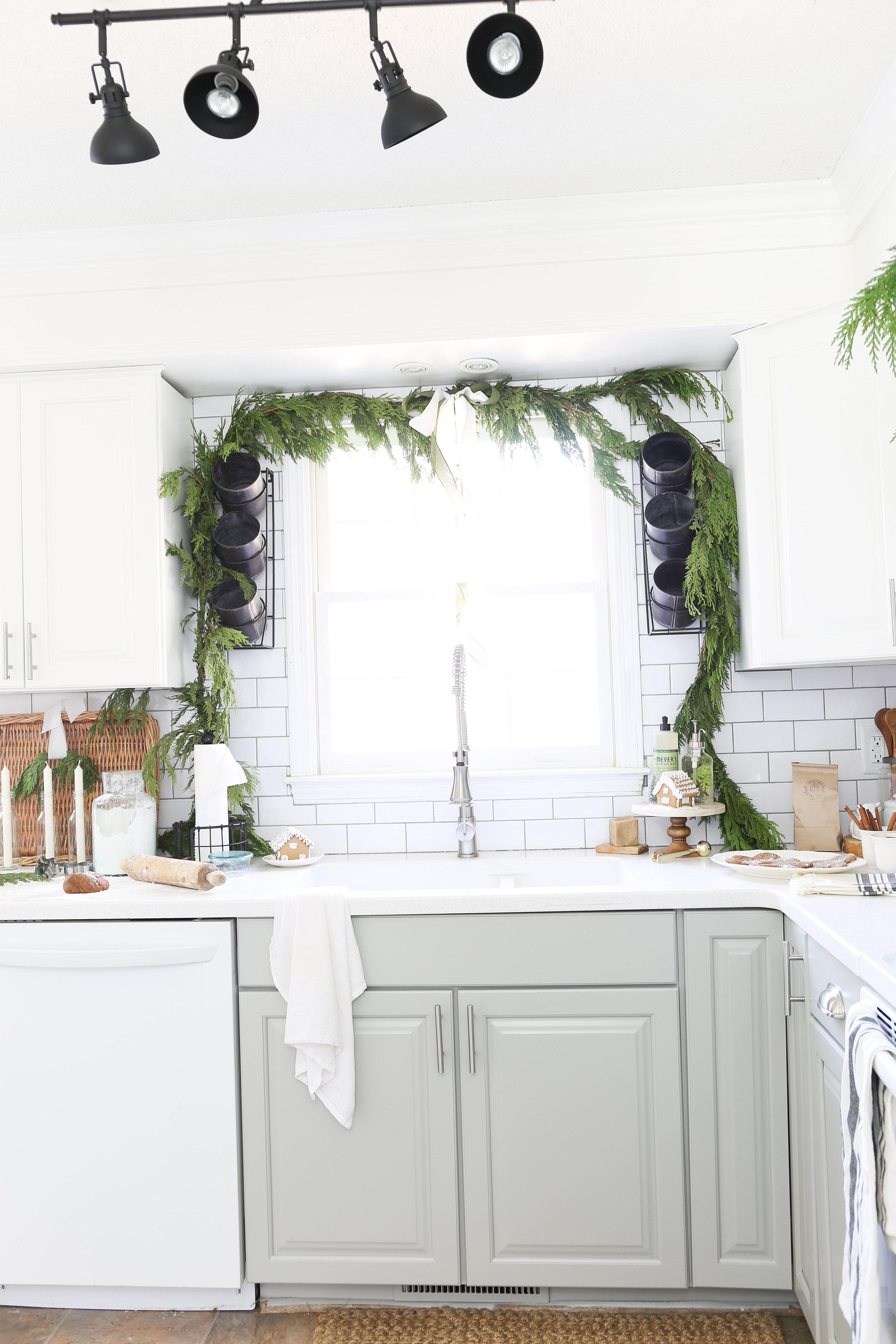 Christmas 2017 Home Tour: Deck The Blogs-Garland above kitchen sink- Plum Pretty Decor & Design's Christmas Home Tour