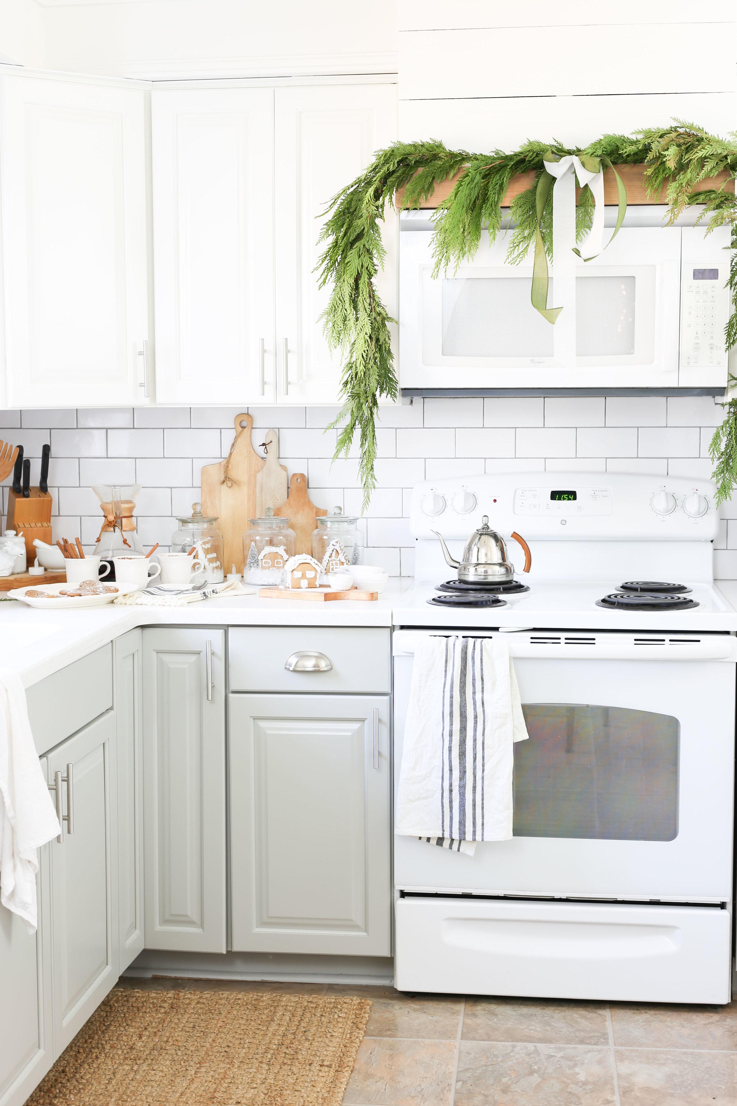Christmas 2017 Home Tour: Deck The Blogs-Kitchen Christmas Decor with Live Cedar Garland and Gingerbread Houses- Plum Pretty Decor & Design's Christmas Home Tour