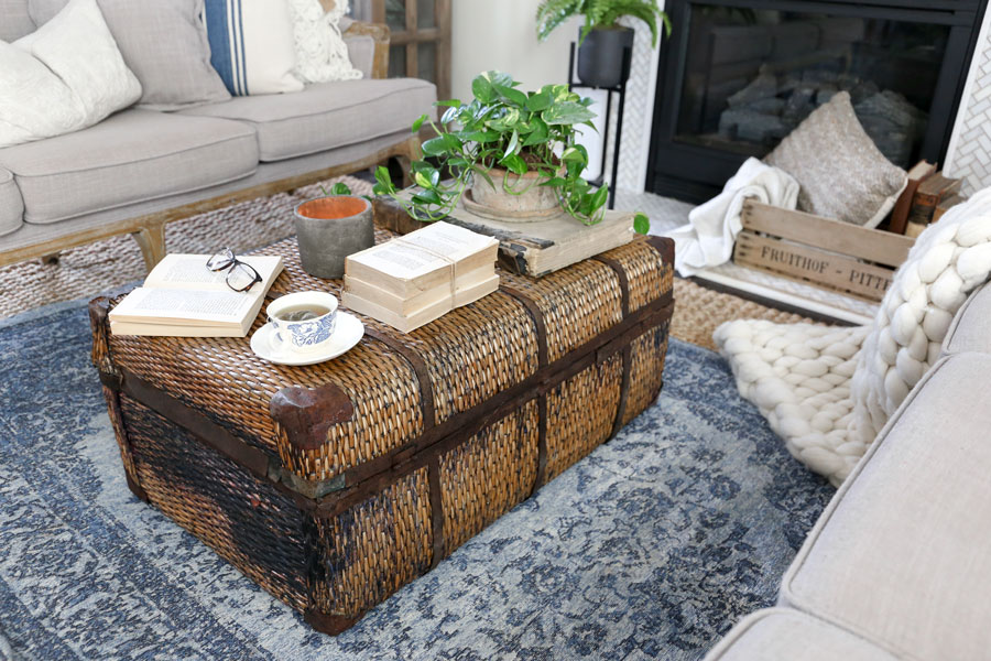 Using an antique trunk as a coffee table in a modern farmhouse living room update with HomeGoods- by Plum Pretty Decor & Design Co.