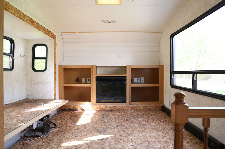 Demo phase of a modern farmhouse camper renovation- front living room area. Design and renovation by Plum Pretty Decor & Design Co.