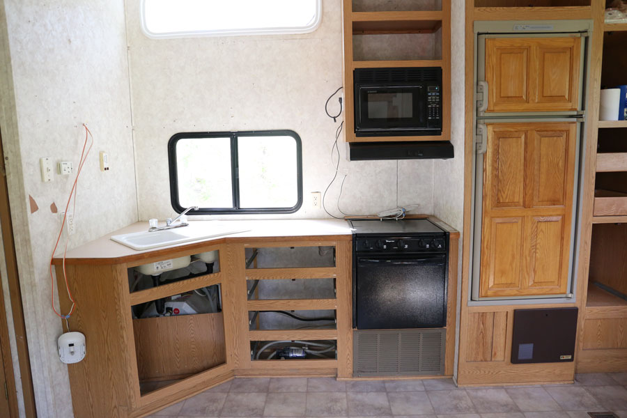 Demo phase of a modern farmhouse camper renovation- kitchen area. Design and renovation by Plum Pretty Decor & Design Co.