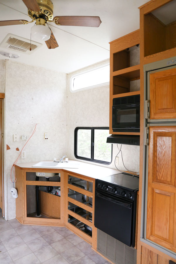 Demo phase of a modern farmhouse camper renovation- Kitchen.  Design and renovation by Plum Pretty Decor & Design Co.