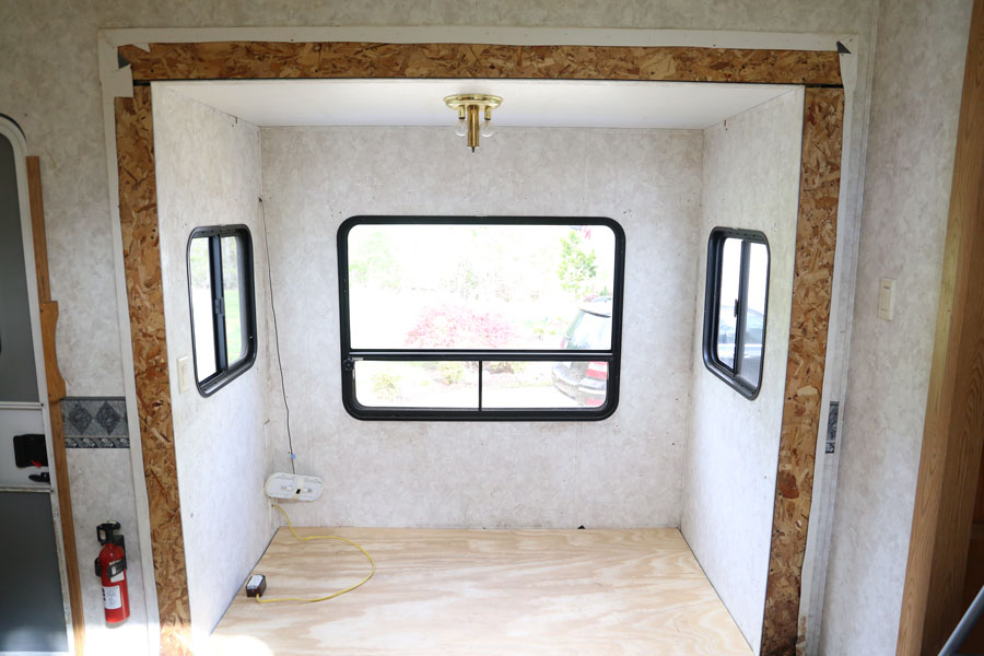 Demo phase of a modern farmhouse camper renovation- Dining area. Design and renovation by Plum Pretty Decor & Design Co.