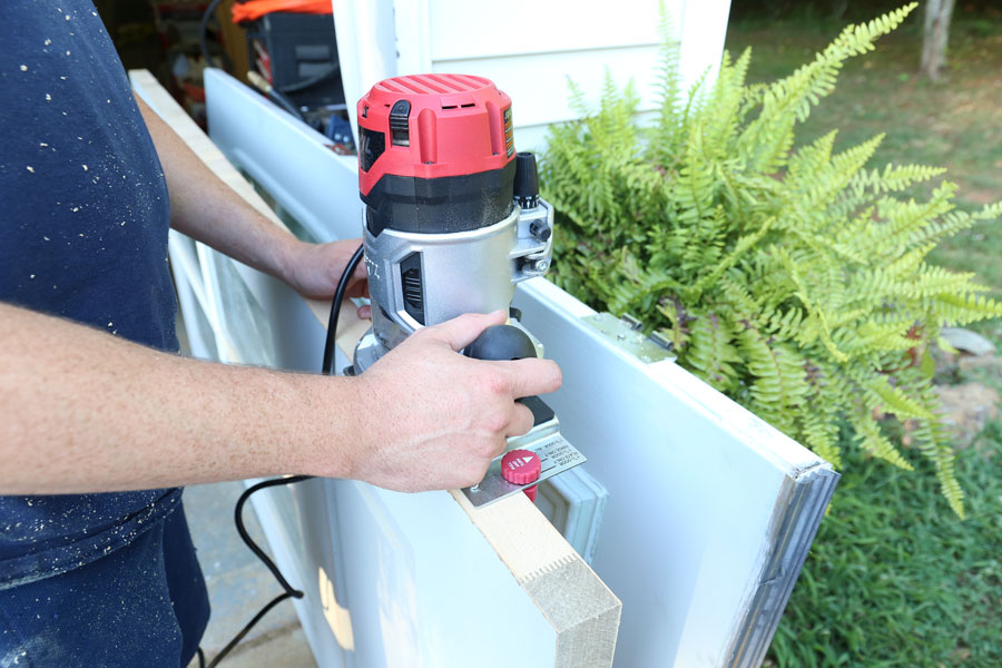 How to install an exterior front door using a hinge kit and router.