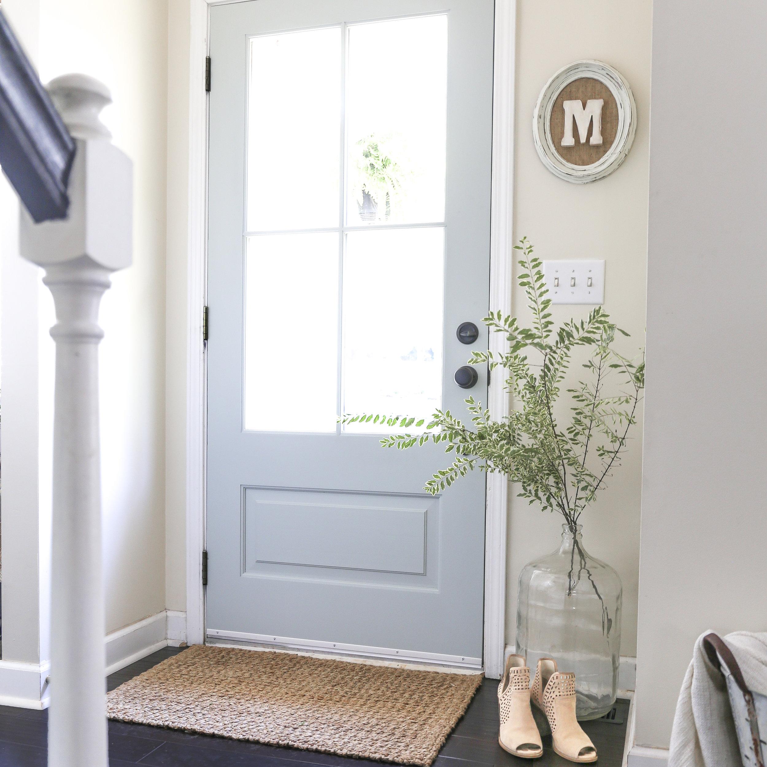 How to install an exterior front door with Simpson Door Company- Light blue modern farmhouse style door.