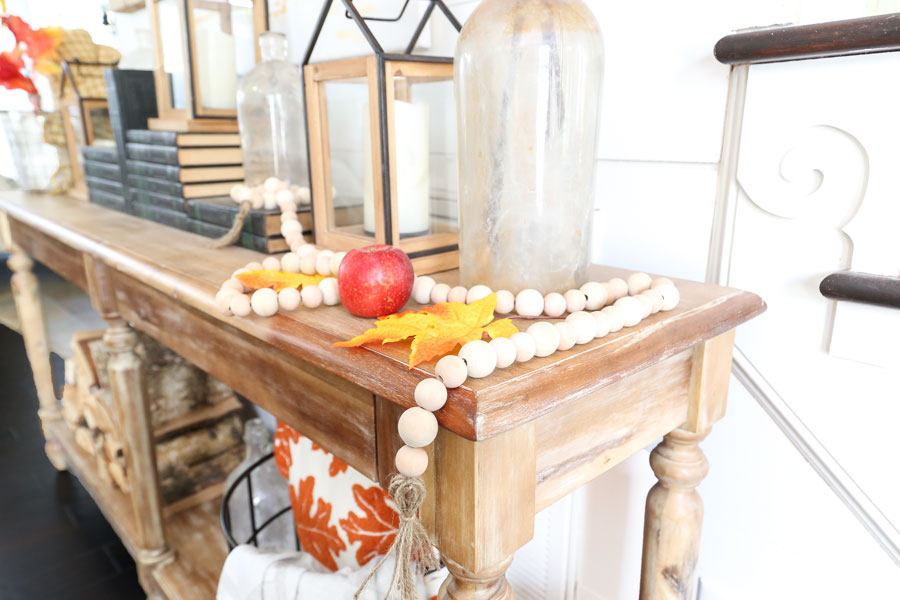 Fall entryway table decor and a DIY wood bead garland with Joann. By Plum Pretty Decor & Design