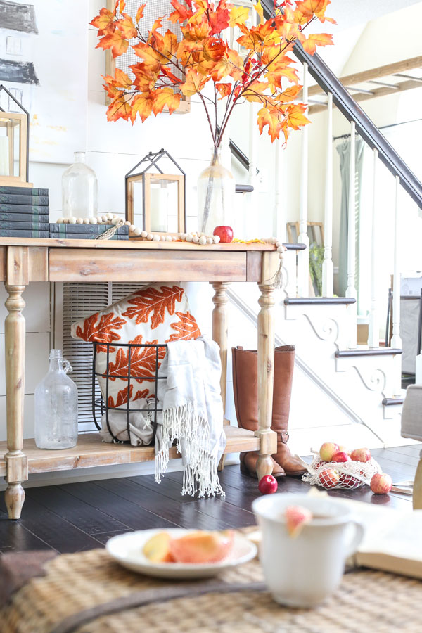 Fall entryway decor using leaves and the color orange with items from Joann. By Plum Pretty Decor & Design.