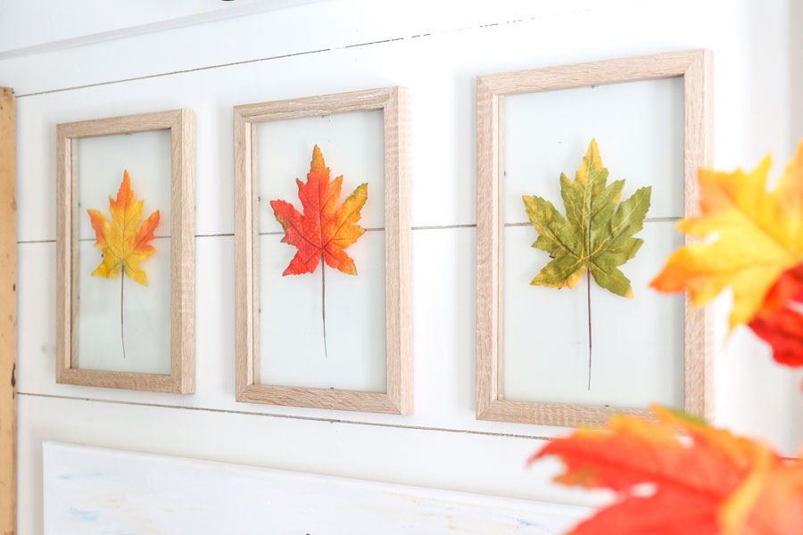 Entryway fall decor using framed leaves and products from Joann. By Plum Pretty Decor & Design.