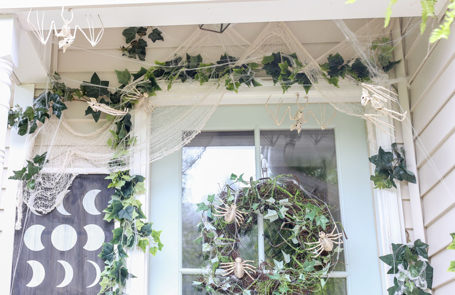 Halloween Front Porch Decor with Spooky Ivy and Skeletons. Plum Pretty Decor and Design partnered with JOANN to bring this Halloween look alive. See the entire look on the Plum Pretty Blog.