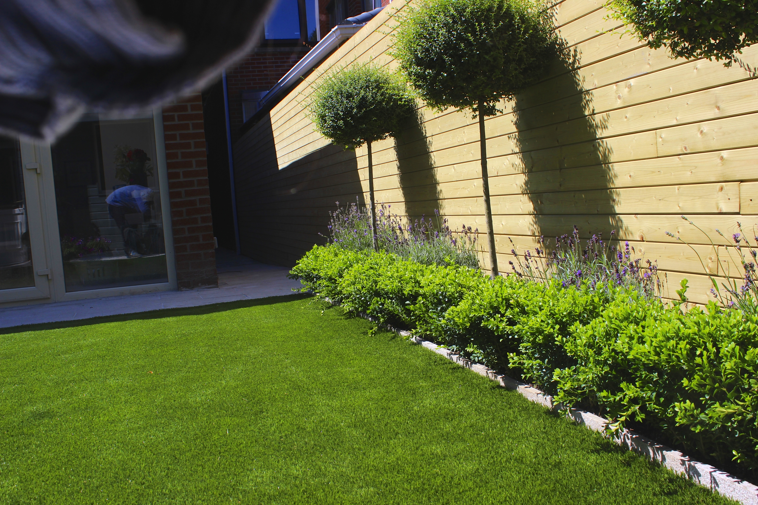 Contemporary formal garden with artificial grass