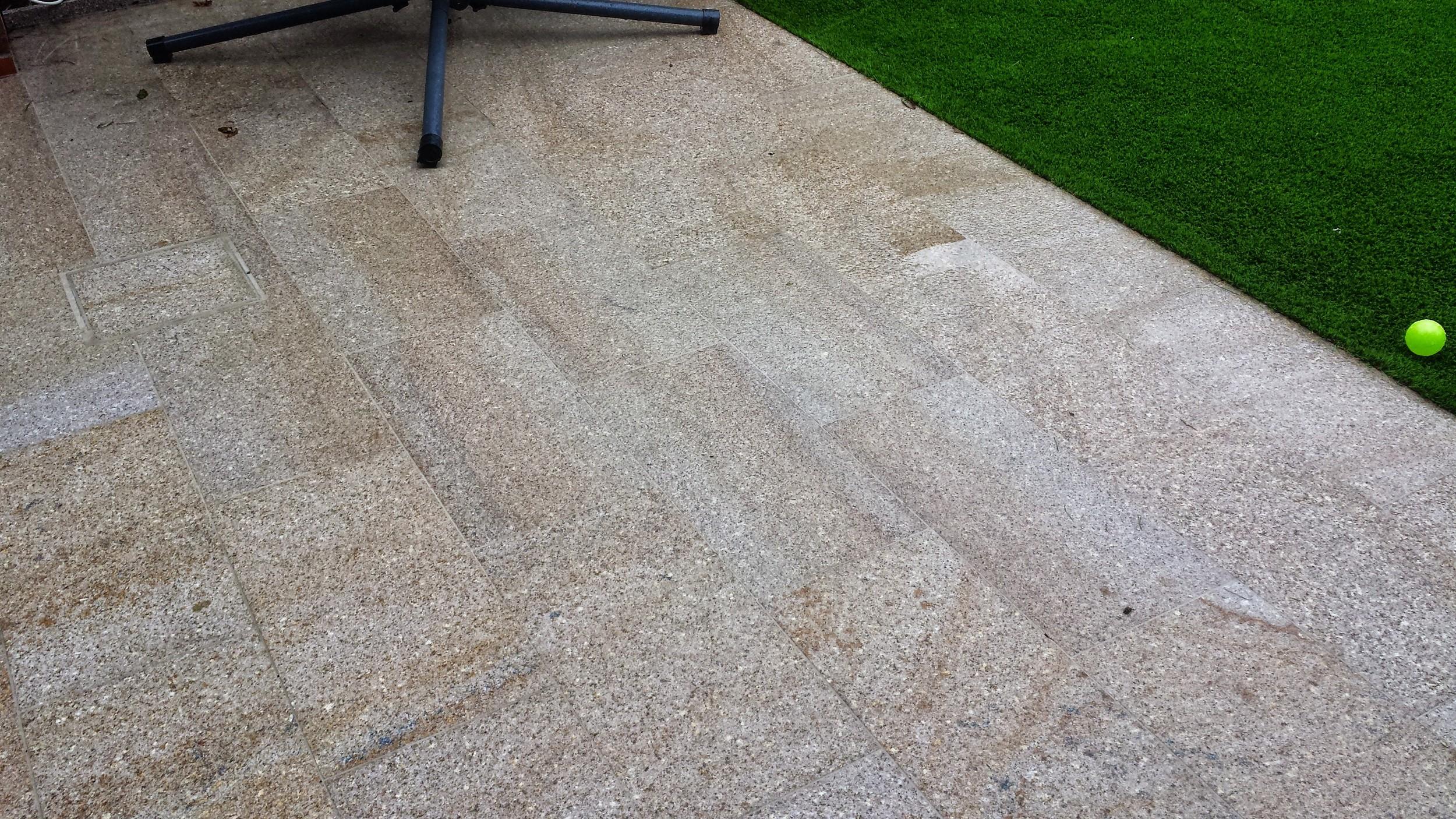 granite paving and grass