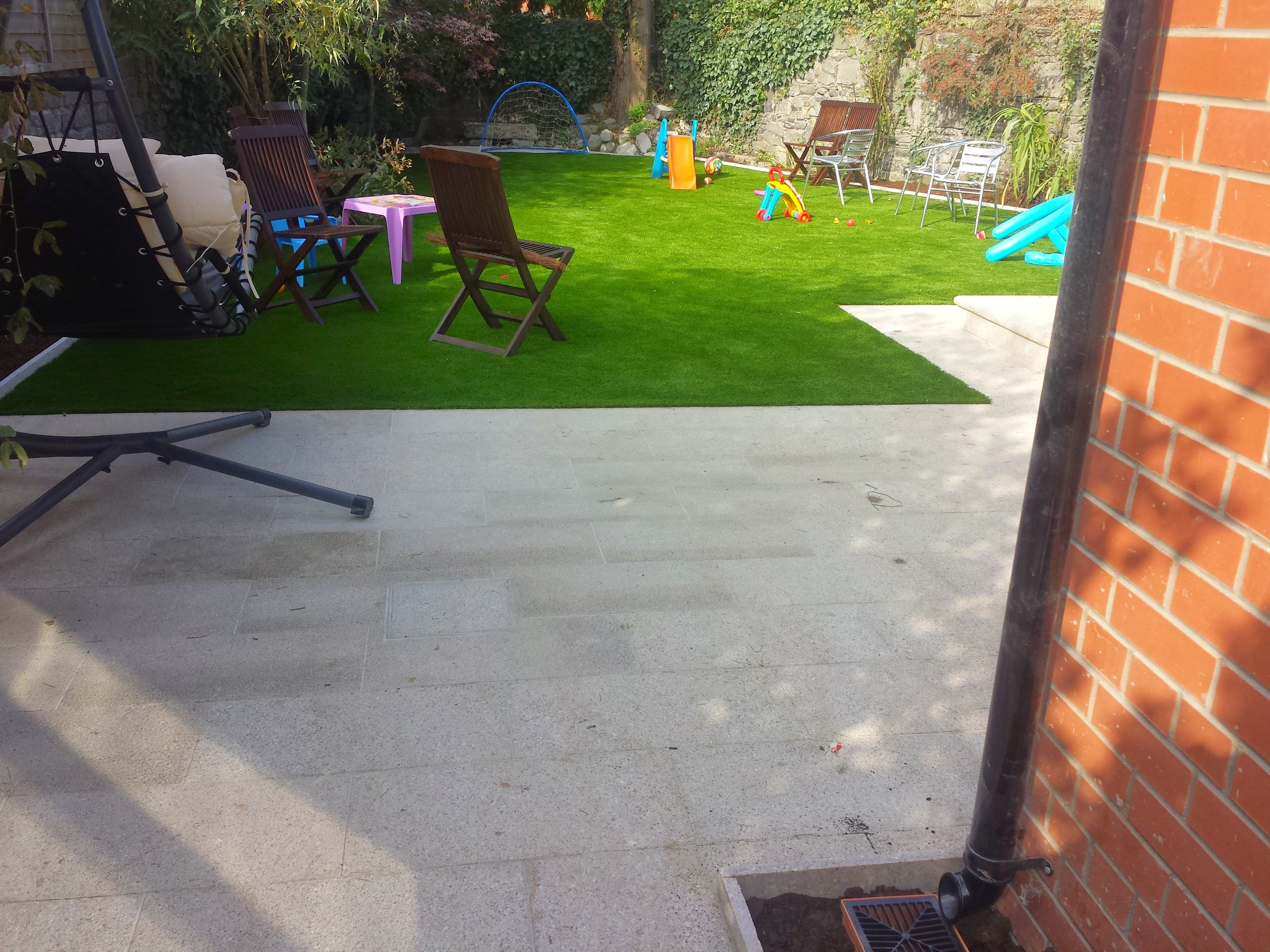 garden grass and granite patio