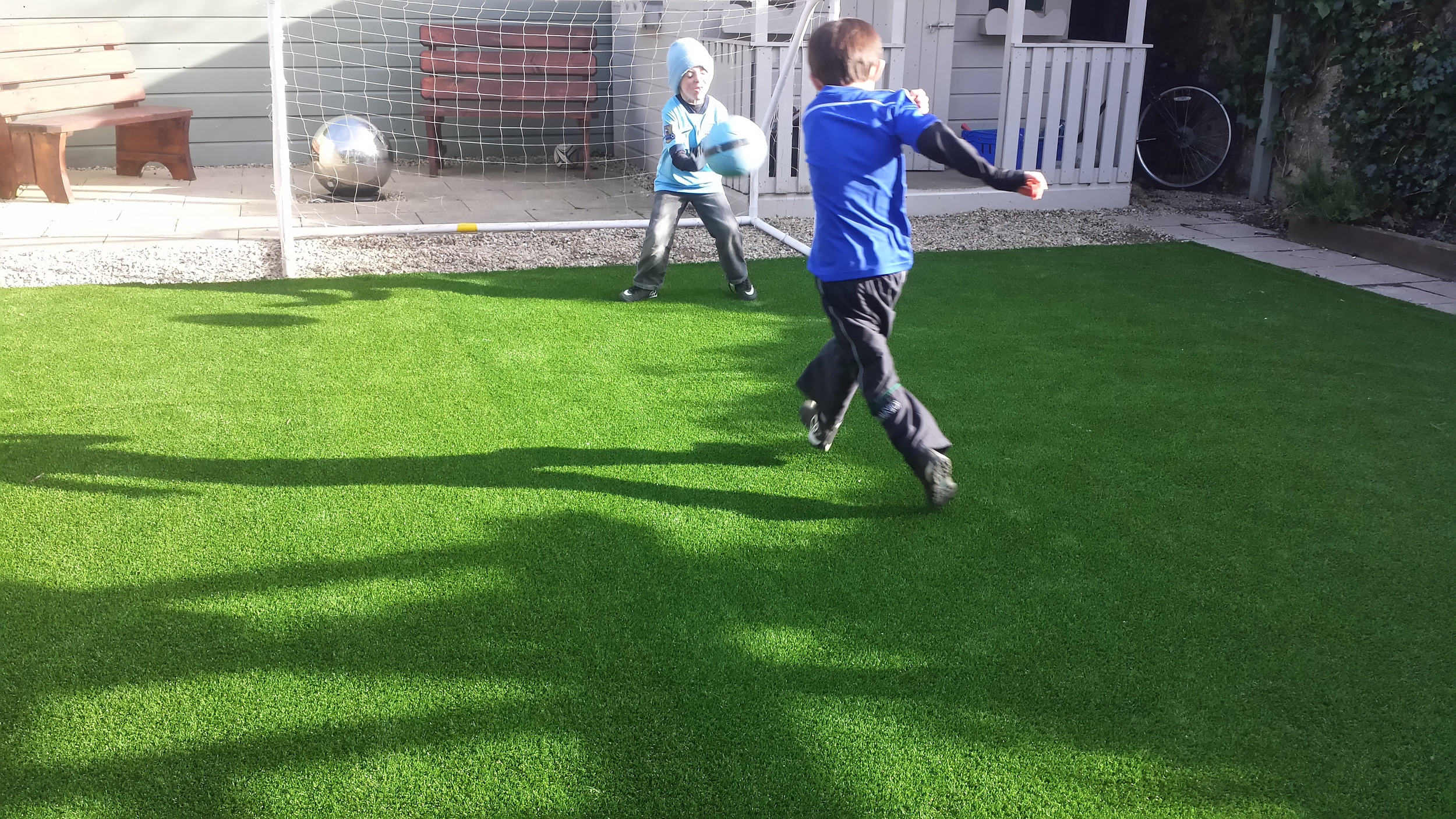kids playing on turf