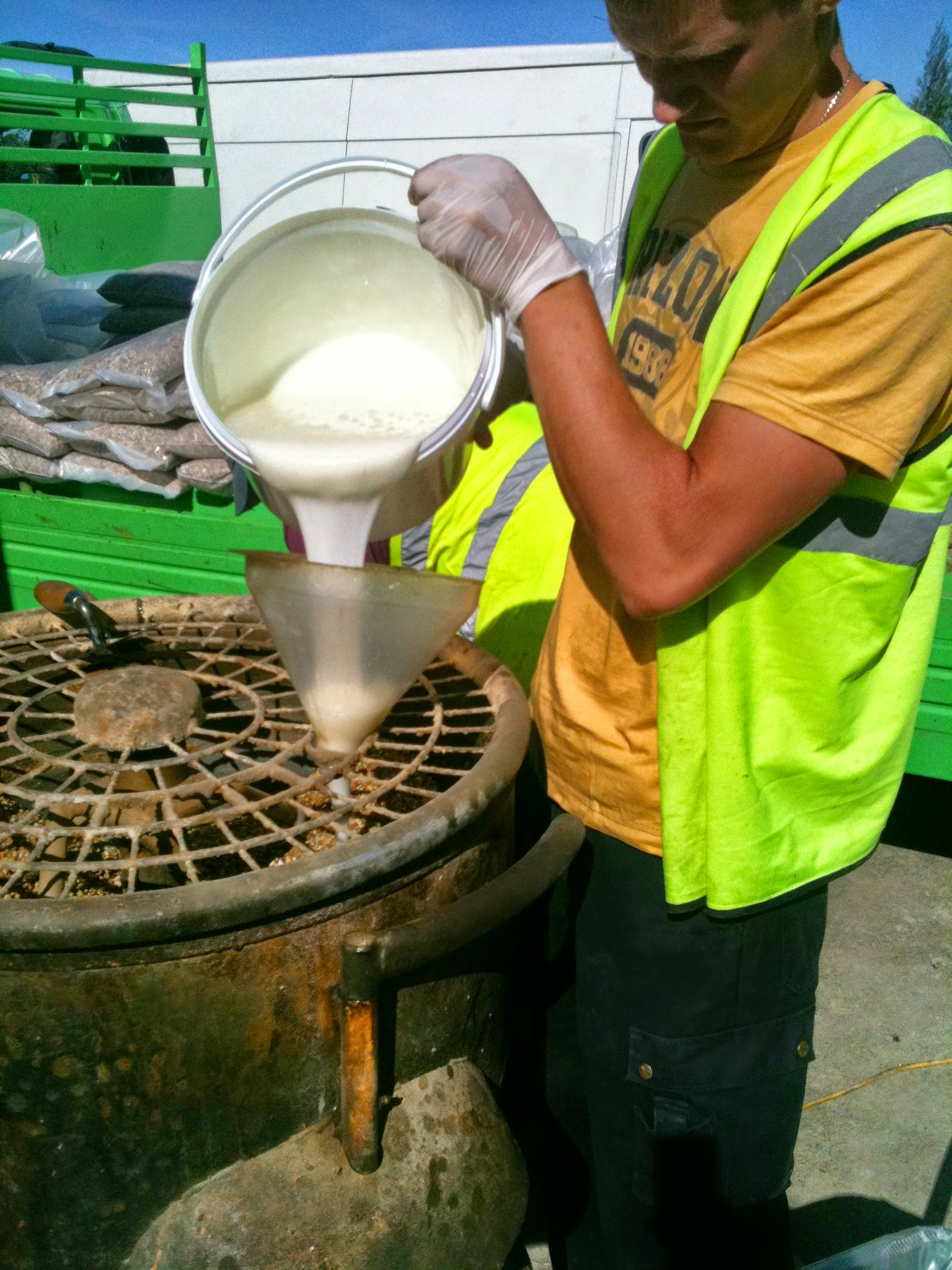 mixing the hard pack for resin bonded surface.JPG