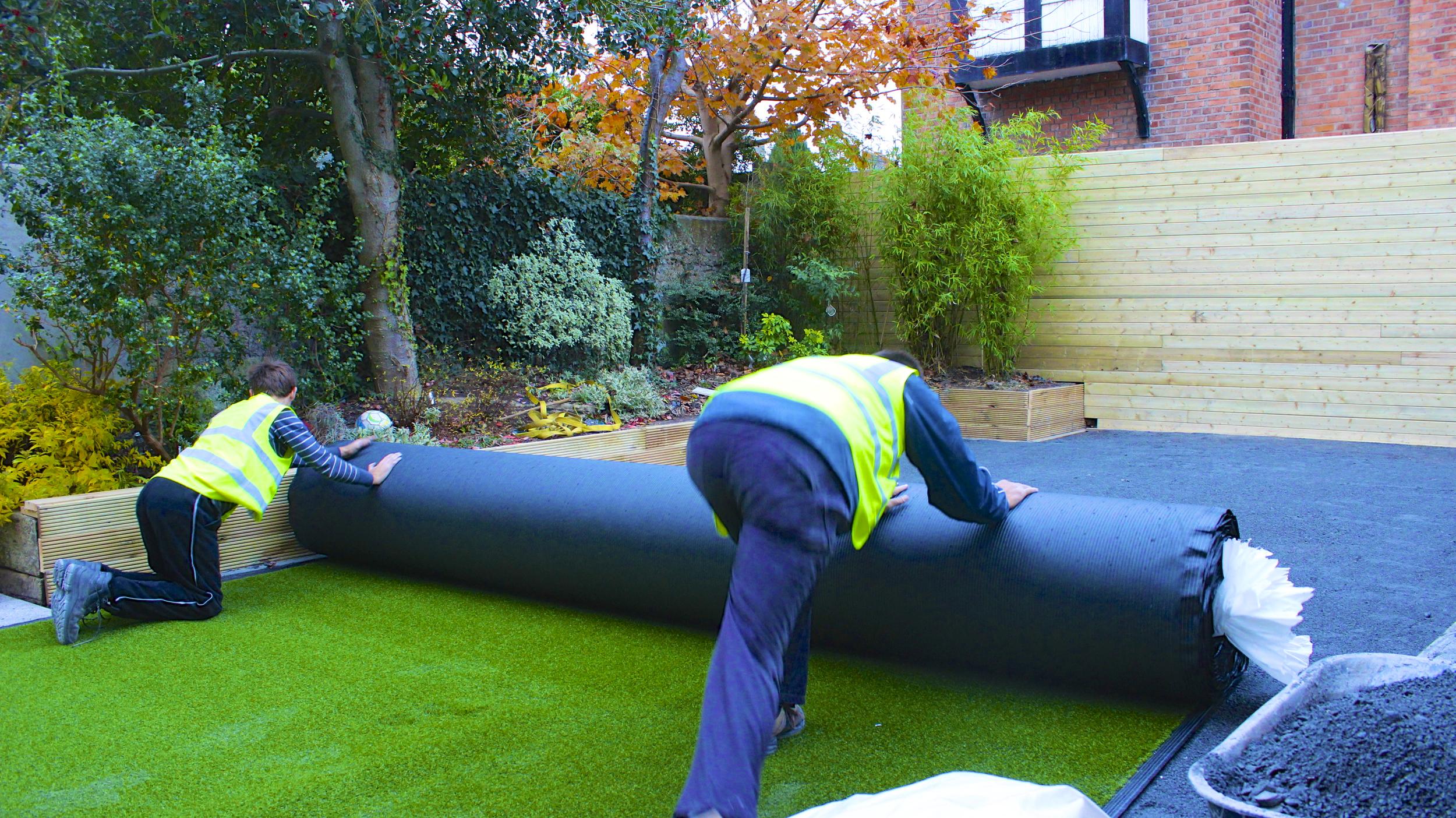 unrolling artificial grass