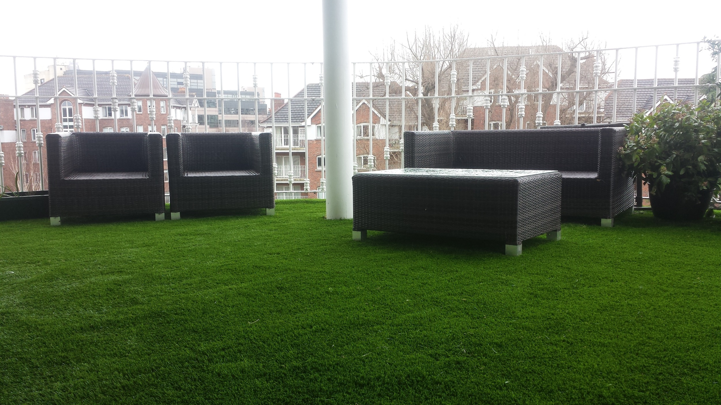 grass and furniture on balcony