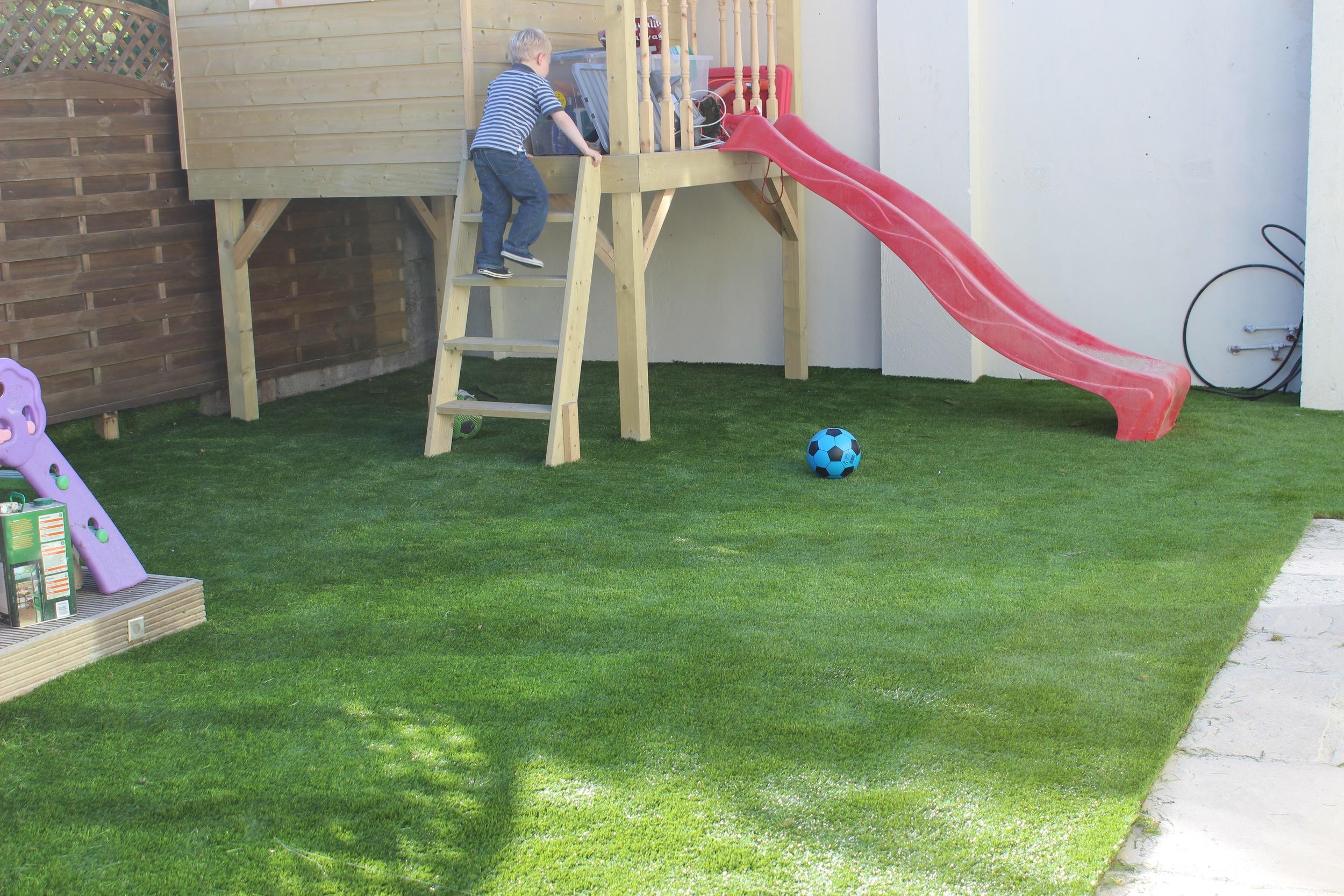 kids playing on playhouse