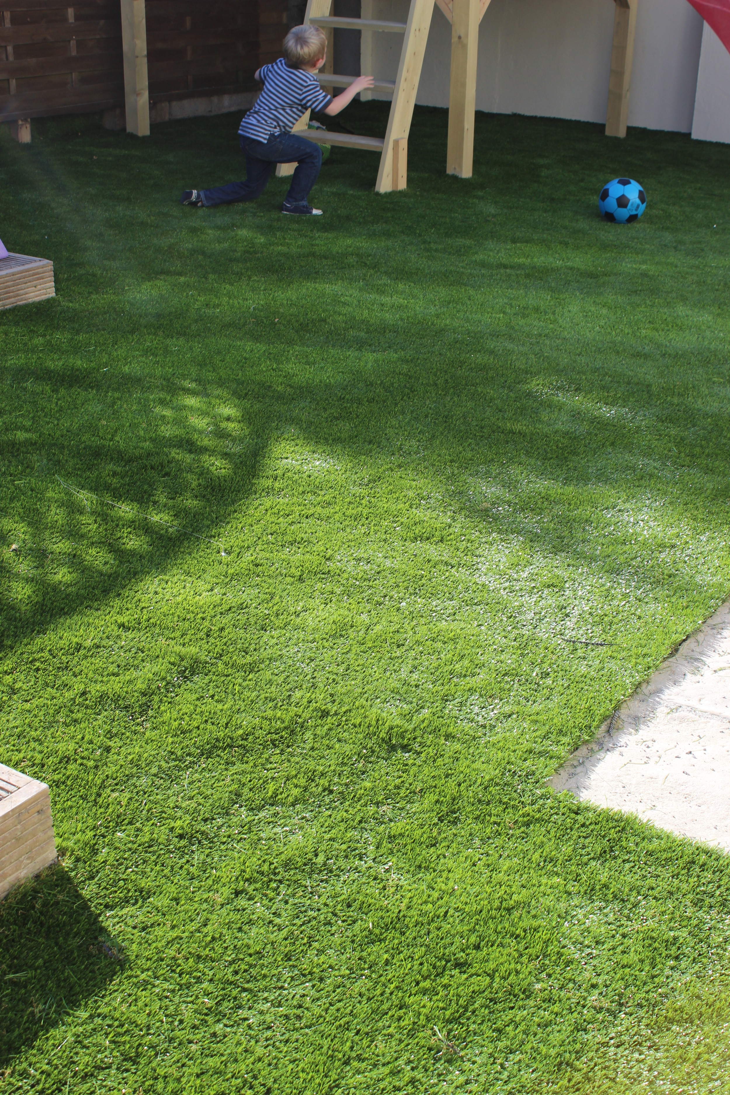 kids playing safely on astroturf