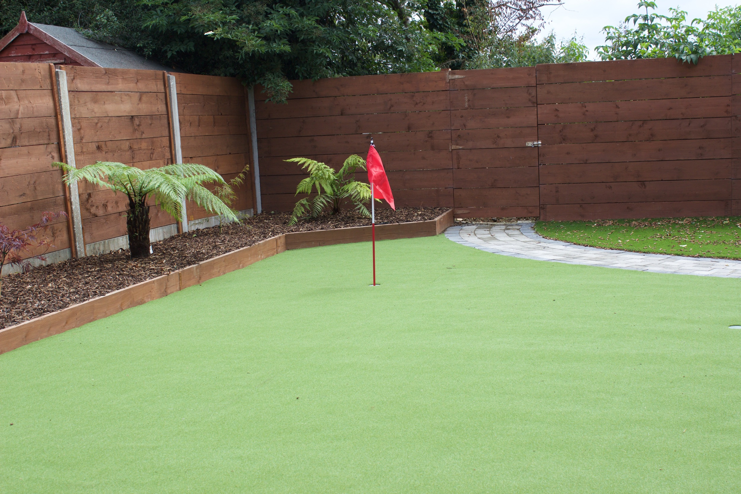 garden landscaping with golf putting green.jpg