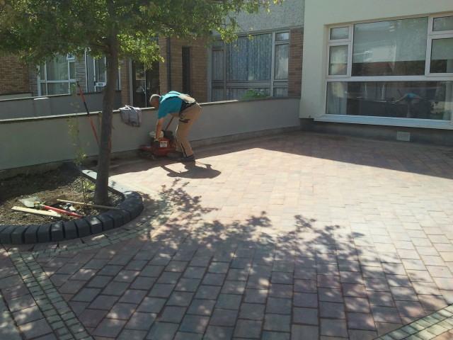 landscaper installing paving