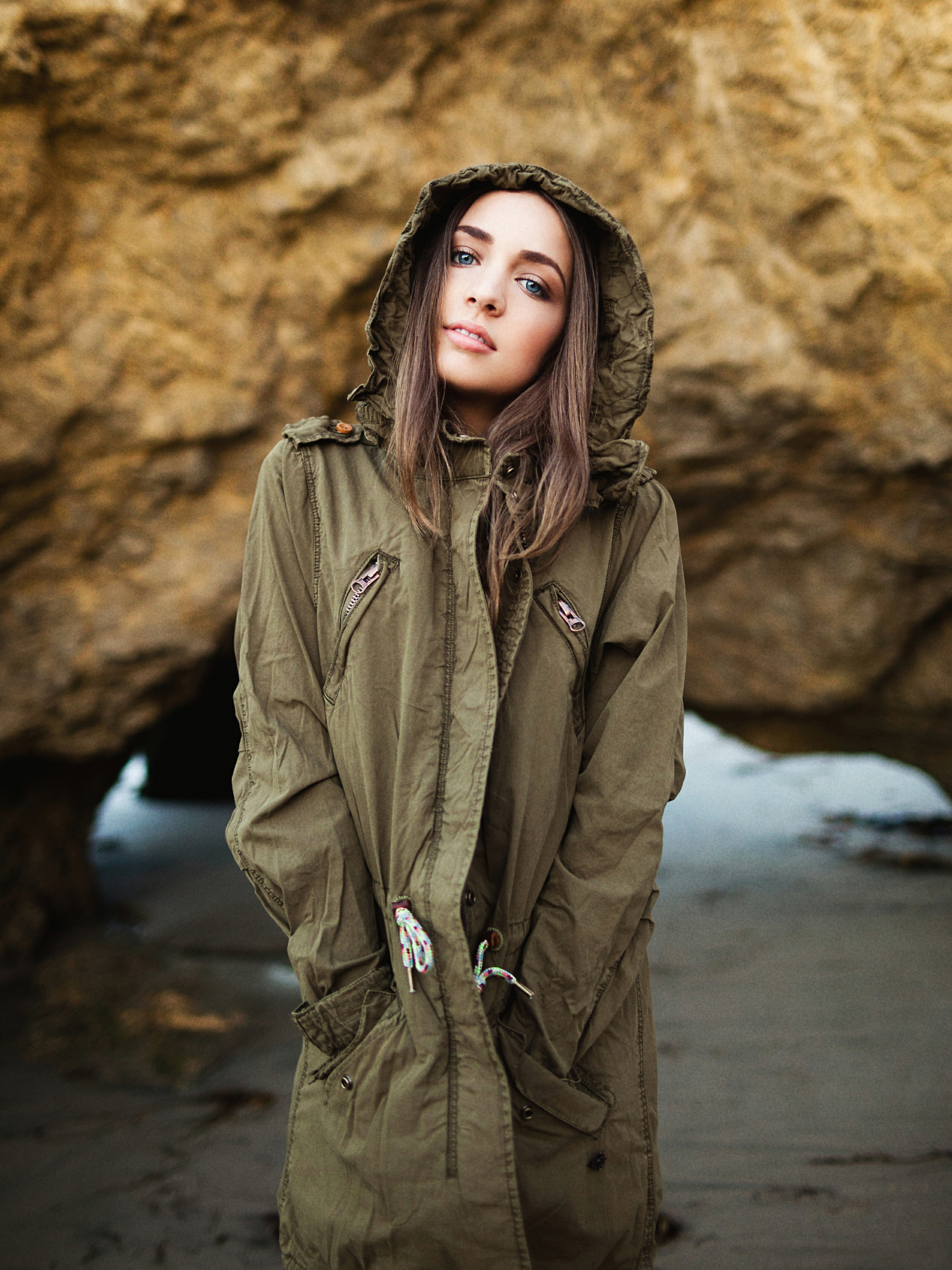 5D III + 50L  During this shoot in Malibu I'm assuming that wearing this coat that's clearly more at home in the PNW attracted those overcast skies that typically stick around up there too. I was planning on shooting pretty heavily backlit but to avoid any dark, muddy skin tones (that typically show up in the shadows when it's overcast) I had Madison face the direction of the light and I had her tilt her head up a bit so it hit her at a more flattering angle. Shooting her in front of a darker backgroundalso helped her pop out of the frame in a scene where the light was all pretty flat.