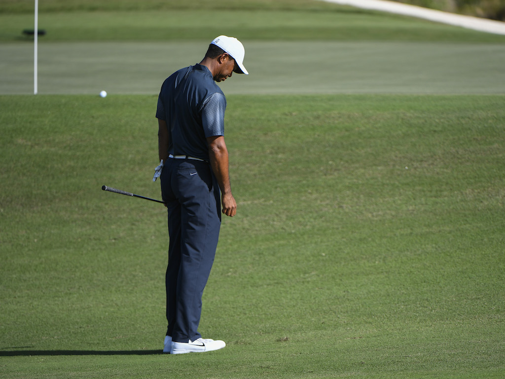 "Many viewers of Tiger's return (including his  former coach, Hank Haney ) observed his difficulty with a few ""sticky"" chips around the greens at the 2017 Hero World Challenge — it should be noted that other players did also have a similar problem dealing with the tight lies around the Albany greens, most notably Hideki Matsuyama. But Woods, who has had more consistent issues in the last few years, stubbed the ground behind the golf ball on a number of shots this week, and half-skulled a few others while trying to avoid the same result. We can pass it off as ""rust,"" but we have seen it from him before. So let's talk about it for a bit.  The ""yips,"" as they are known, are one of the most frustrating problems that plague golfers, particularly professional golfers. The  physical  causes of the yips are well known; this is not some esoteric information known only to great players and coaches. We all know the  physical reasons, but the yips are not simply a physical problem. In fact, the physical might be a small part of the problem. The biggest part is the mental.  Everyone reading this has  yipped a chip , and we all know that the very next time that shot presents itself we are thinking about the yip. It's difficult (if not impossible) to dismiss that last shot from the mind. And if it happens more than once, or more than few times, it might be  permanently  on one's mind. That's a huge problem if you play the game for a living. Brandel Chamblee, with whom I have publicly disagreed in the past, has a theory on this. He believes no great player has ever really gotten over the condition. I can't say if that's true or not, but it may be.  It's been said, (I have read that Sam Snead might have said it first, but who knows where these things ever really come from) about the yips: ""Once you've had 'em, you've got 'em."" How's that for a scary thought? Who knows if it's true, but one thing I do know is this; golf always seems to go for the jugular!  It seems as though every time I have ever stubbed a chip shot, very soon, if not the very next hole, I have to hit another chip from a tight lie. If I've just missed a short putt, very soon, if not the next hole, it also seems like I'll knock it 5 feet past the hole. And what am I thinking about? You guessed it, the last missed short putt. So no amount of mental discipline seems to overcome these evil thoughts.  Hitting the ground behind the ball on a short shot is caused by one or any combinations of the following:  The leading edge of the wedge sticking in the ground  An early release with a closing face  Swaying off the ball  A path that is too inside-out (too far from the inside)  But as I noted, every tour player and coach KNOWS this all too well. The same player who once chipped in from behind the 16th green at Augusta with a Green Jacket on the line yipped some sticky chips last week. To me, that is not rust or a mechanical problem; it's a mental one. I would like some professional psychologist or mind-discipline expert to chime in to advise all of us on how to overcome this problem. It's easy enough to say: ""Forget about it, stay present, play the shot at hand only."" But that seems almost impossible, or at the very least, difficult to do. ""Don't think about yipping this shot"" is almost a sure fire way to do just that. It's a vicious cycle.  If it's on Tiger's mind, the rest of us are in big trouble. Let's hope Chamblee is wrong, but I have to wonder. Remember the down time in golf far exceeds any other game.  We are on the golf course 4+ hours, and in the act of swinging a club a total of only about two minutes. The rest of the time is thinking about swinging the club, and the outcomes. And unfortunately what we usually think about is the WORST shot we have hit in a situation, not the best. And when that shot is a short, chip from a tight-lie, well, that's when the yips resurface.  The mechanical is correctable, but the mental is long-lasting.     By    Dennis Clark"