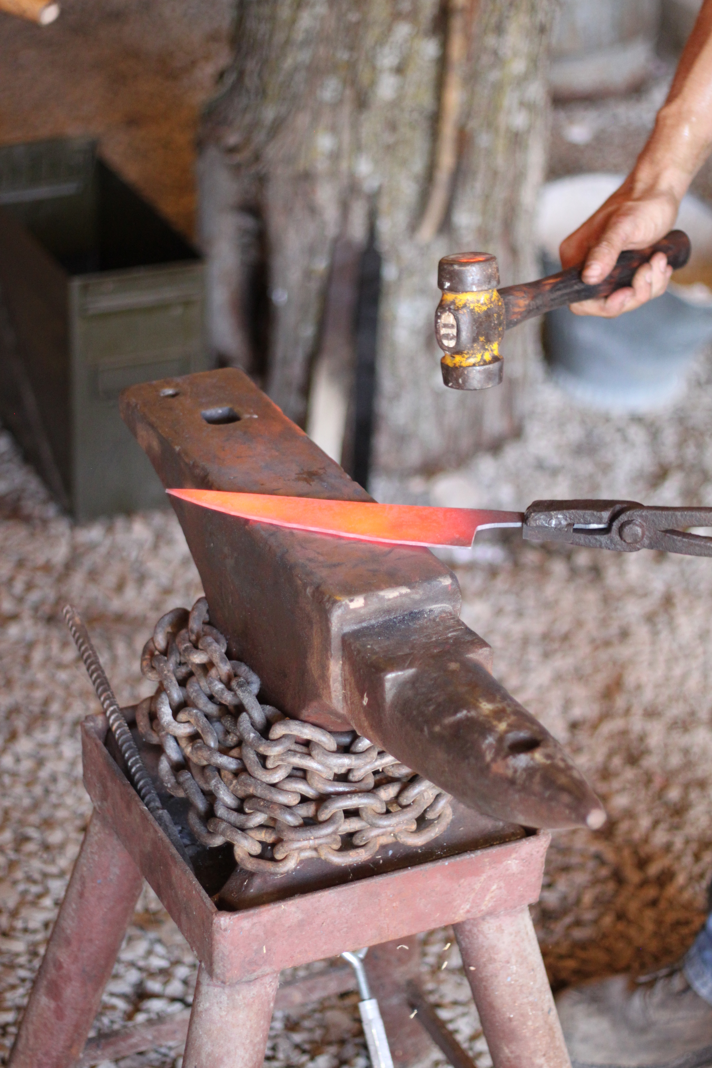 """Forging the bevels of an 8"""" chef knife."""