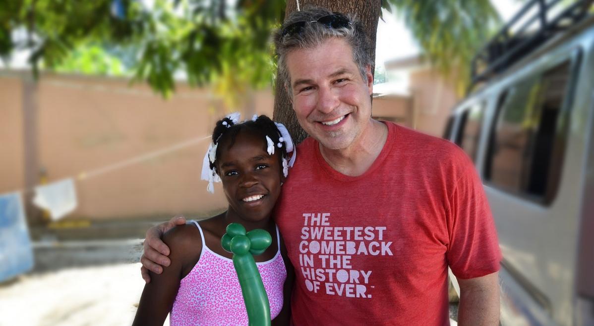 Steve Siewert with an orphan named Lovely. What a precious girl.