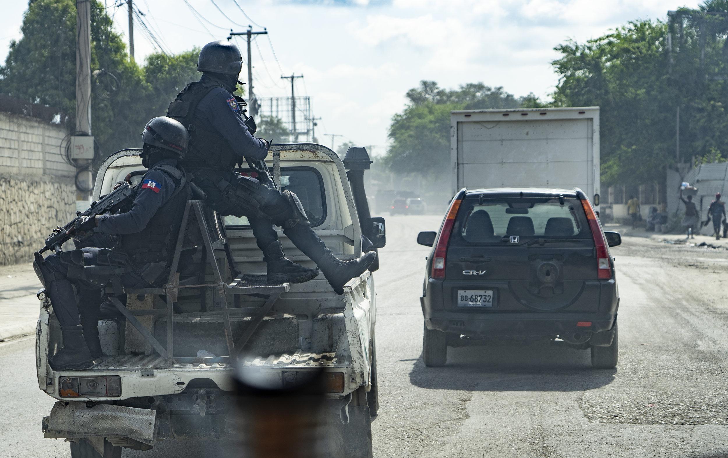 Police Heading to a riot near Port Au Prince, Haiti.