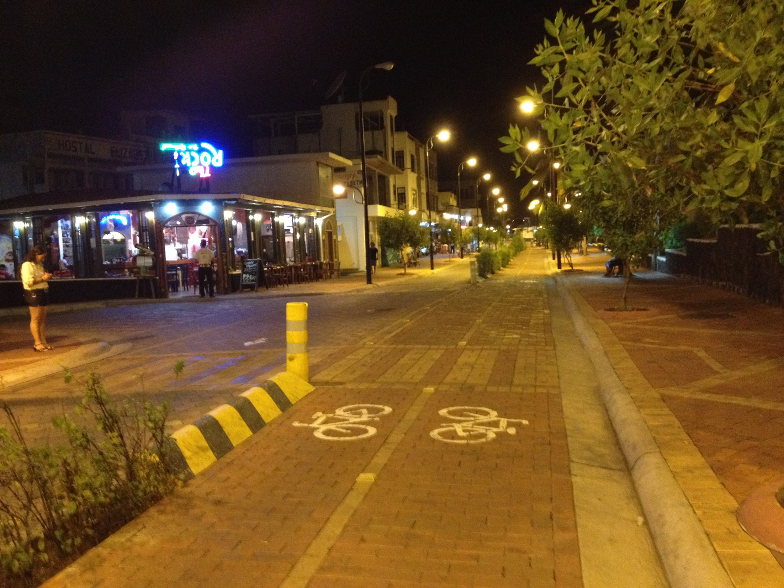 Physical environment prevents traffic fatalities by separating bike and automobile lanes, Puerto Ayora, Galapagos, Ecuador