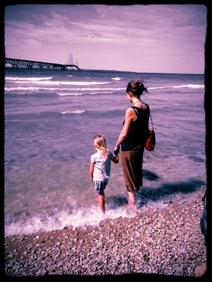 Mom and daughter explore the beach