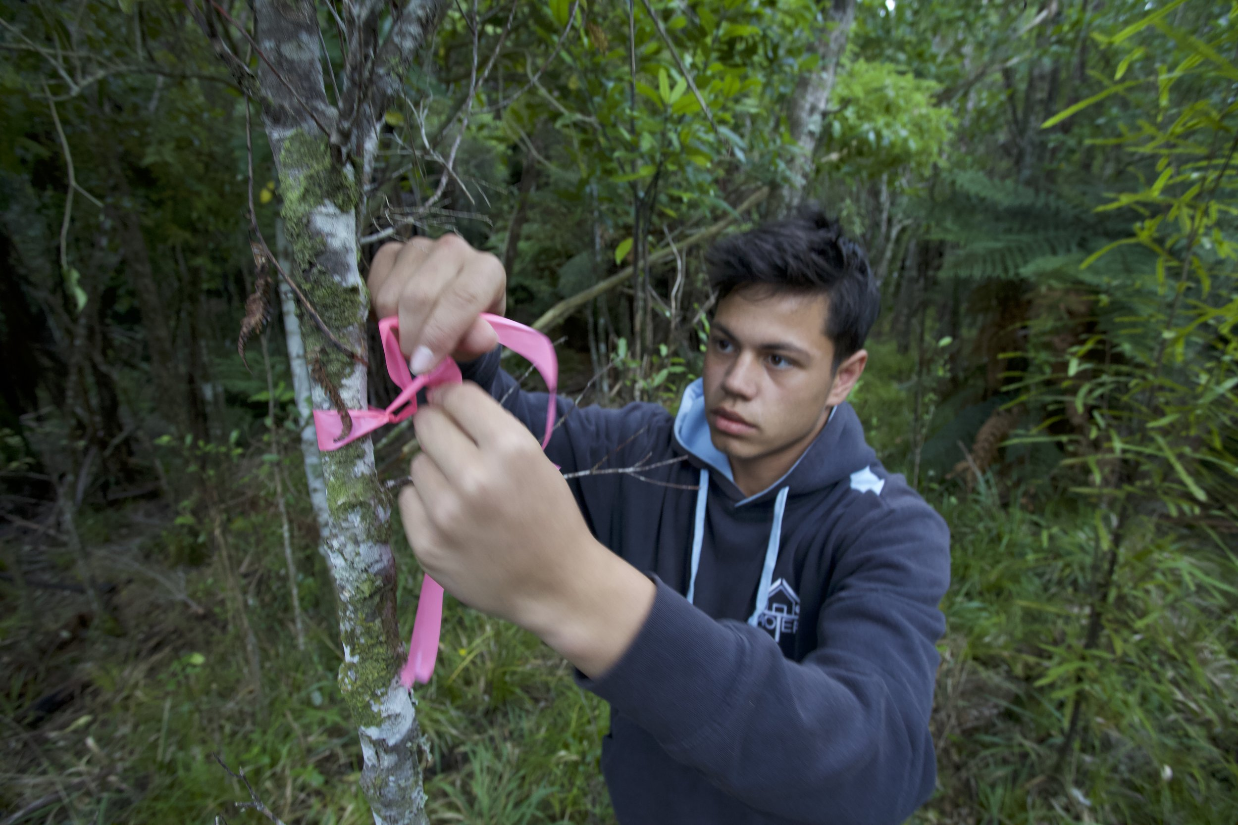 Aotea College students marking where he places his traps in the RImutakas.