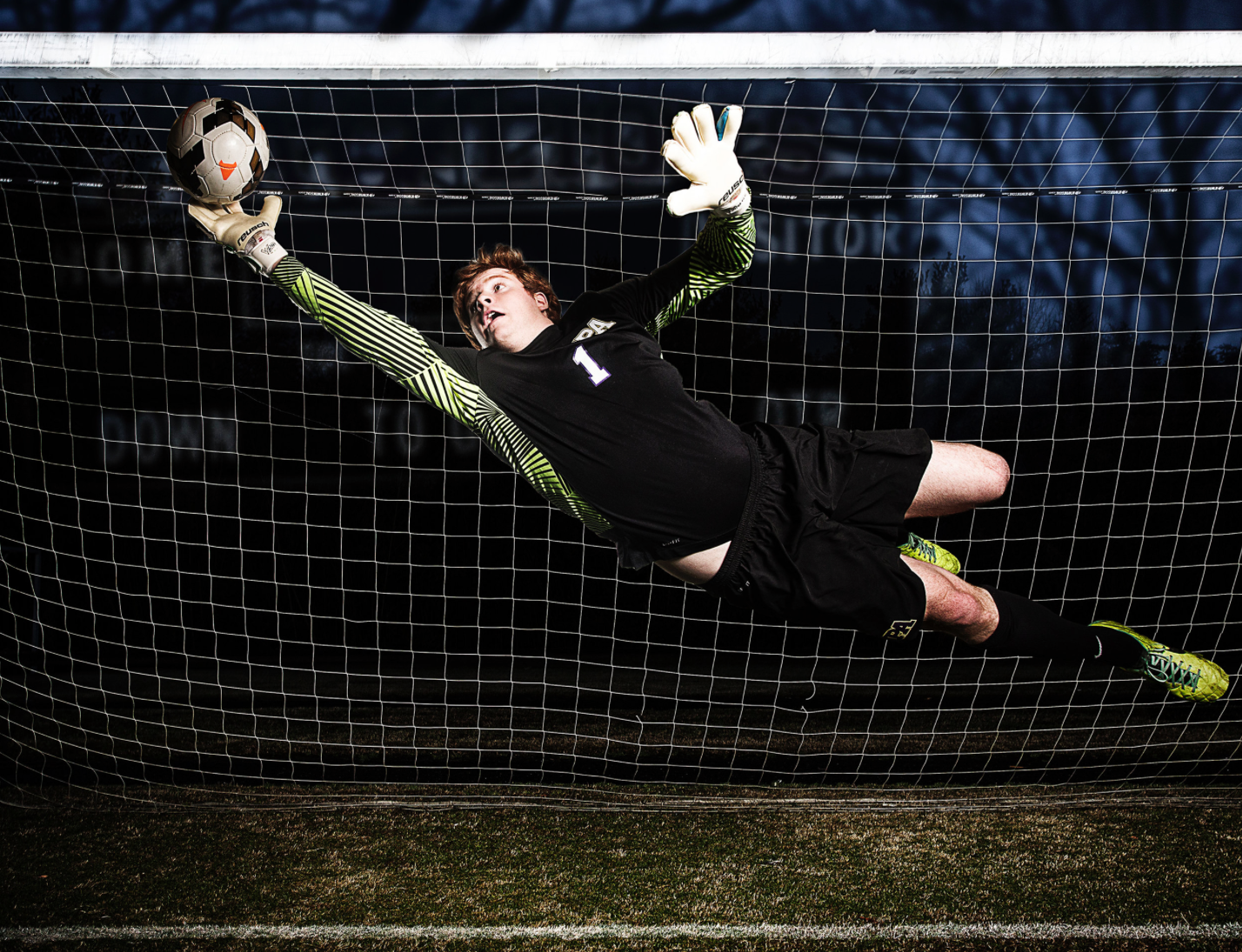 The goalkeeper was shot inside and landed on a high jump pad and was later inserted into the background image.  Asking a goalkeeper make this save multiple times (or even once) for a photo shoot is never an option due to the risk of injury.   The safety of the athlete comes before everything so if you cannot figure out how to do something with that as the priority, you cannot do the shoot.