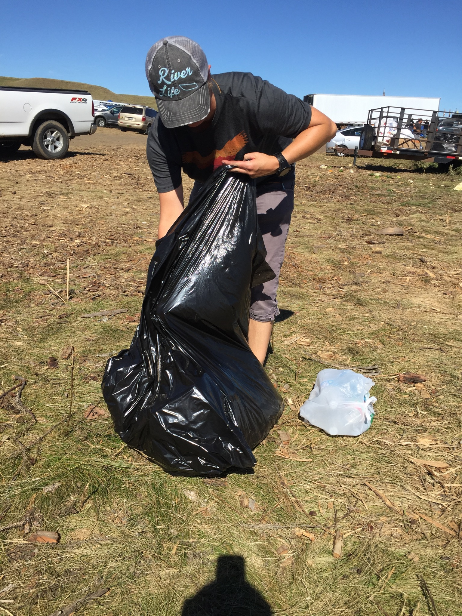 Collecting garbage and recycling from the grounds of the camp. There's a lot of everyday ways to support the community gathered at Oceti Sakowin Camp.
