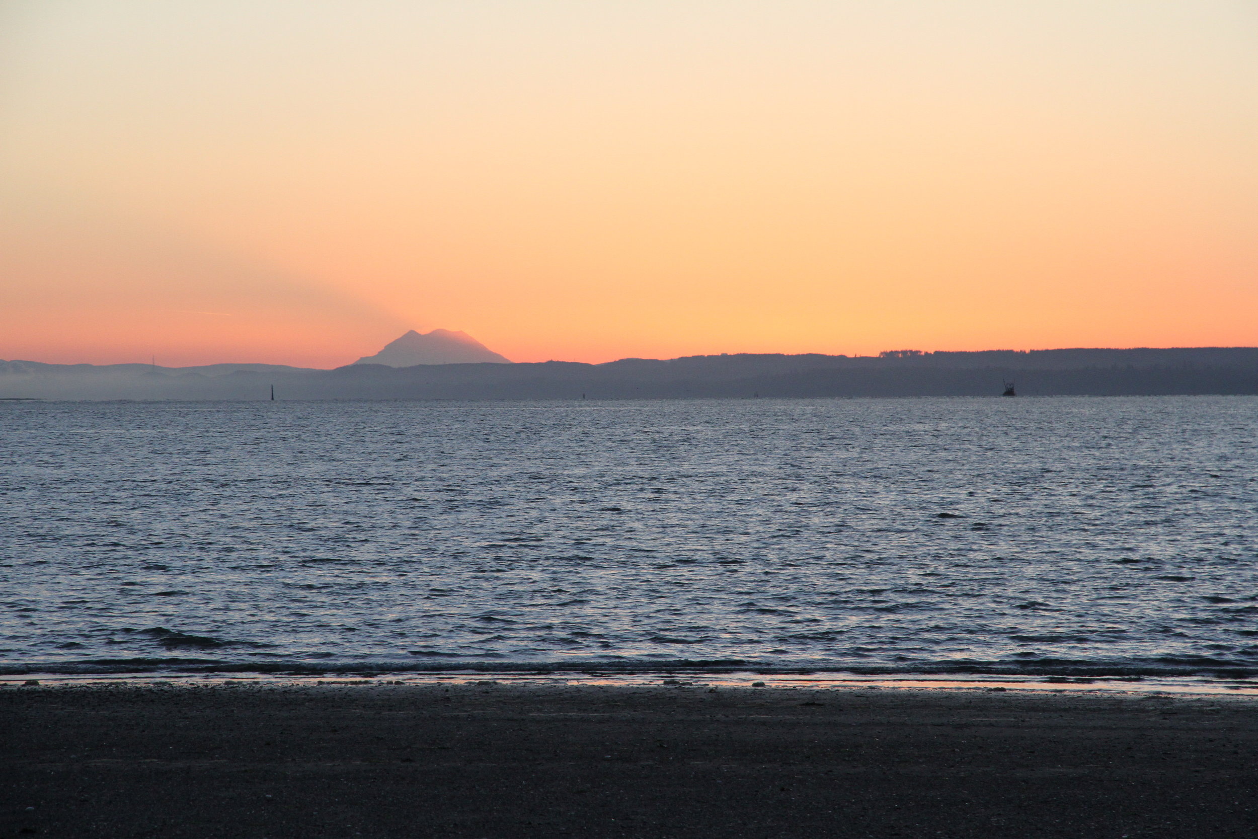 The sun rise and Mt. Rainer cast a shadow over Gray's Harbor. Tanya Pluth photo.
