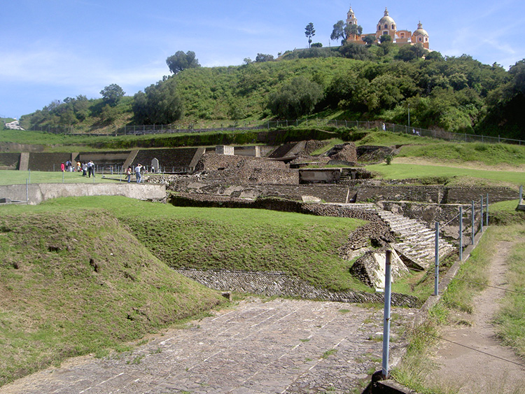 Great Pyramid of Cholula, outside of the City of Puebla.  Photo (unedited) by André Vasconcelos; available at:   https://www.flickr.com/photos/andrellv/4152386111