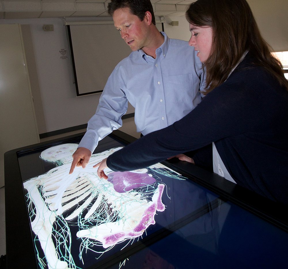 Dr. Dean Smith and Kelsey Venis explore the layers of Anatomage.