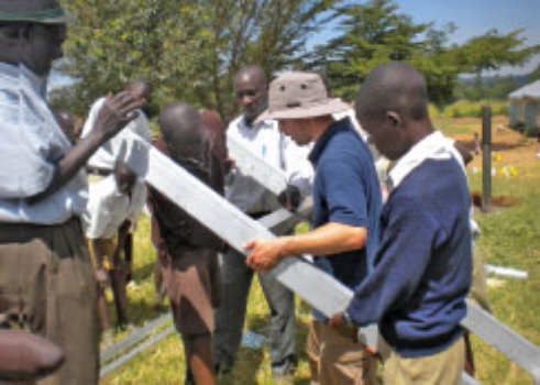 After installing the first Sunflower Solutions emPower Plant in Kenya, Chris Clark '08 demonstrates how to operate it.
