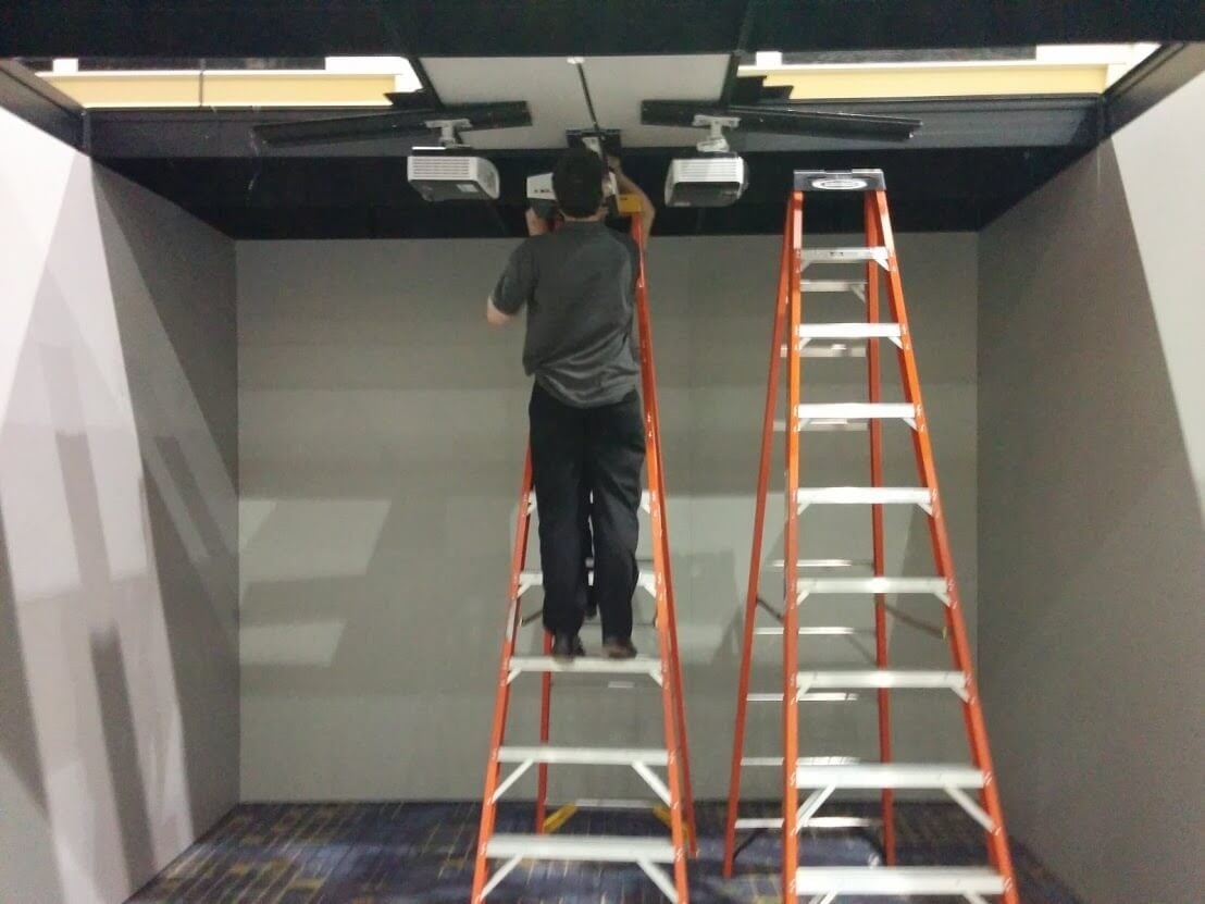... AND INSTALL OUR PROJECTORS
