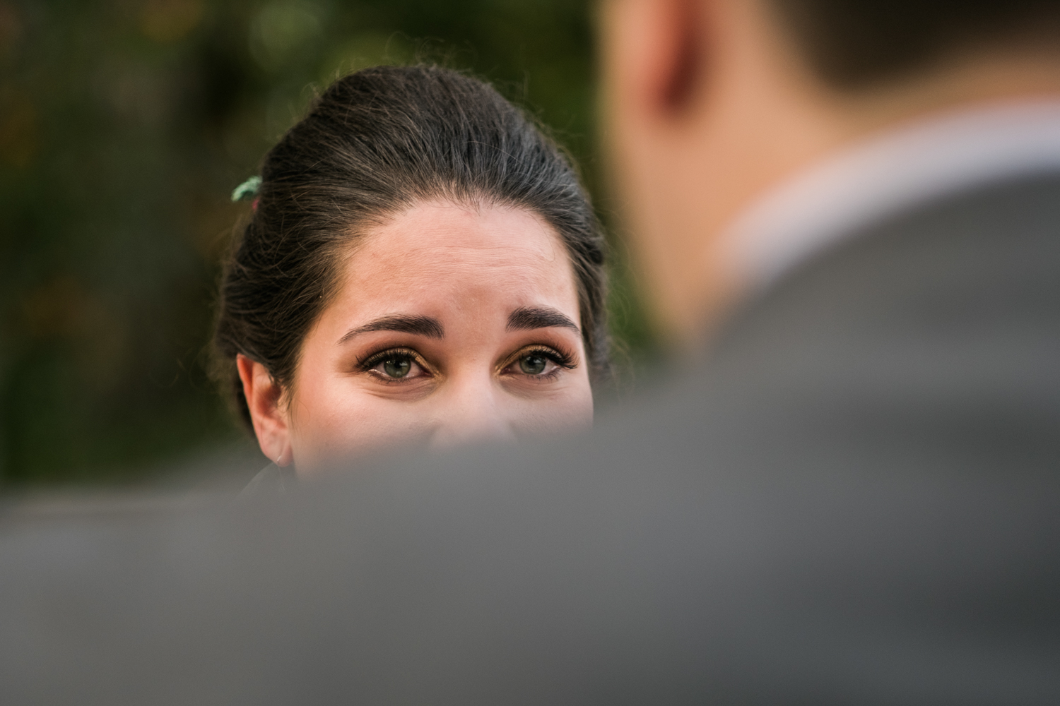 Honorable Mention 2 |Melissa & Patrick | Lake of Isles  Fuji XT2 | Leica Sumilux 50 f1.4  After their Catholic ceremony Melissa and Patrick arrived at the venue and took 10 minutes alone to read each other personal vows that they had written. I peaked over Patrick's shoulder and caught this emotional moment. An easy pick for 2017.